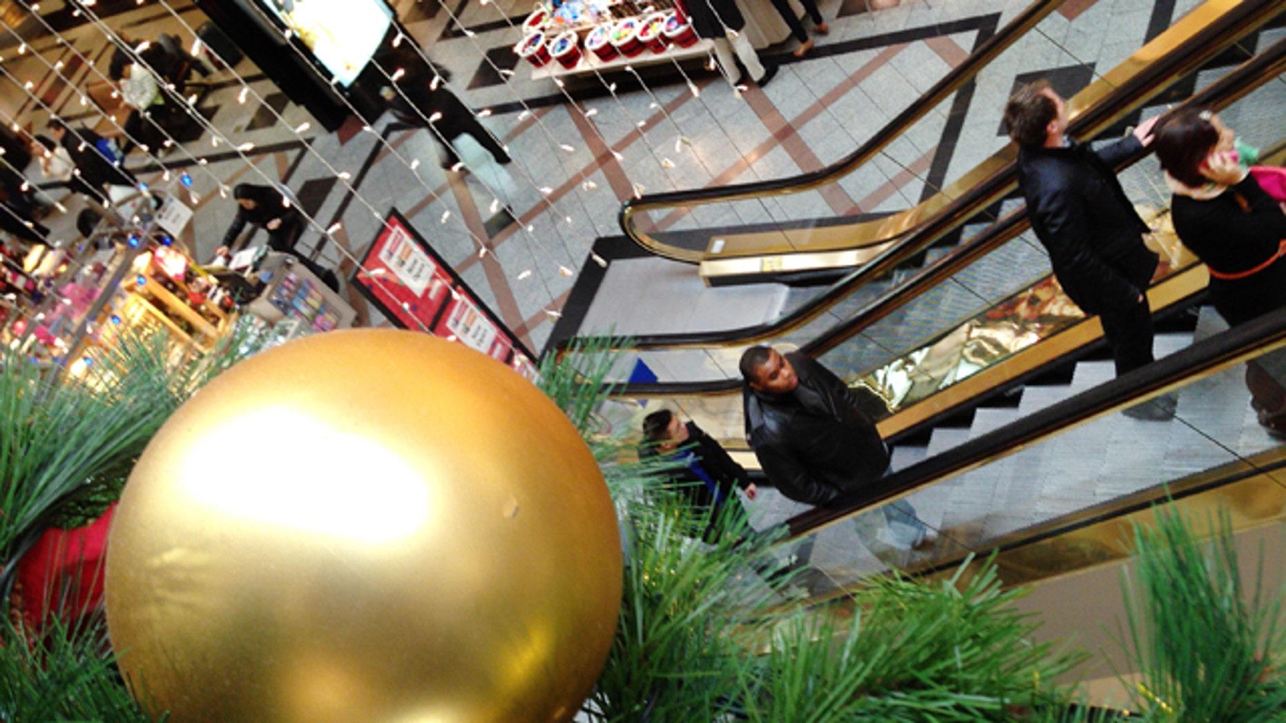 Nov. 26, 2013: Shoppers move through a mall in Cambridge, Mass.
