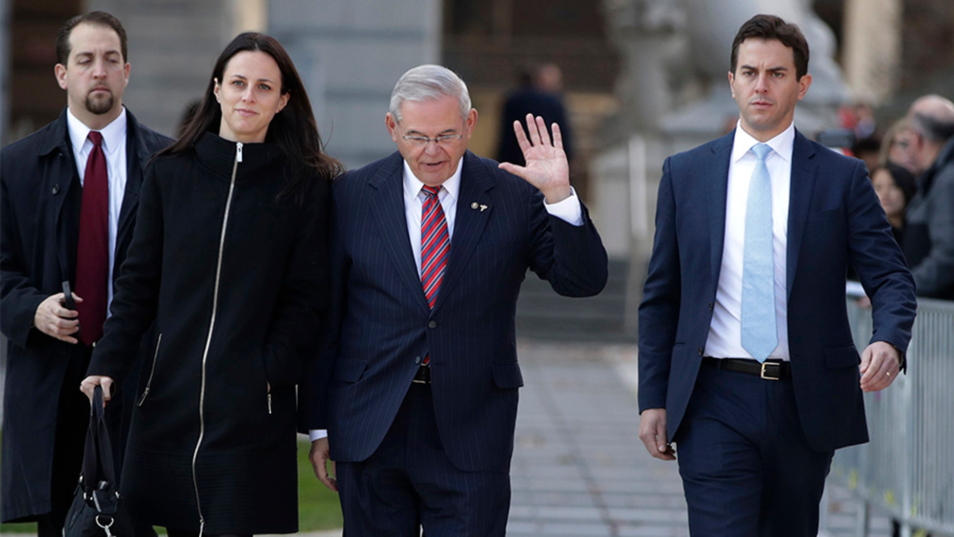 Sen. Bob Menendez, center, walks with his son, Rob, right, and his daughter, Alicia, while leaving Martin Luther King Jr. Federal Courthouse after U.S. District Judge William H. Walls declared a mistrial in Menendez's federal corruption trial, Thursday, Nov. 16, 2017, in Newark, N.J.