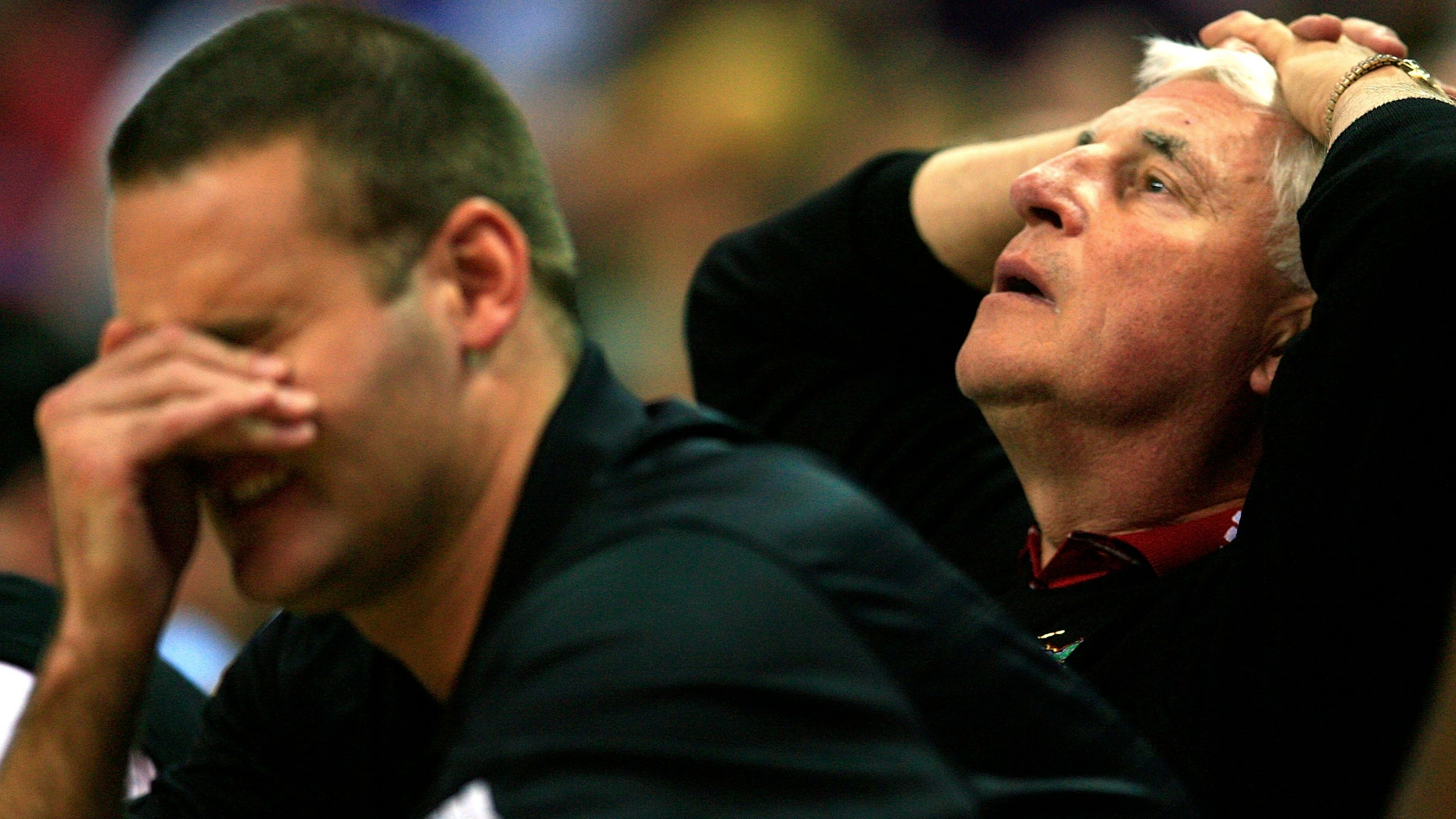 OKLAHOMA CITY - MARCH 09:  Head coach Bob Knight of the Texas Tech Red Raiders and head coach designee and son, Pat Knight, react after a missed basket during the quarterfinal game of the Phillips 66 Big 12 Men's Basketball Championship against the Kansas State Wildcats on March 9, 2007 at the Ford Center in Oklahoma City, Oklahoma.  (Photo by Jamie Squire/Getty Images)