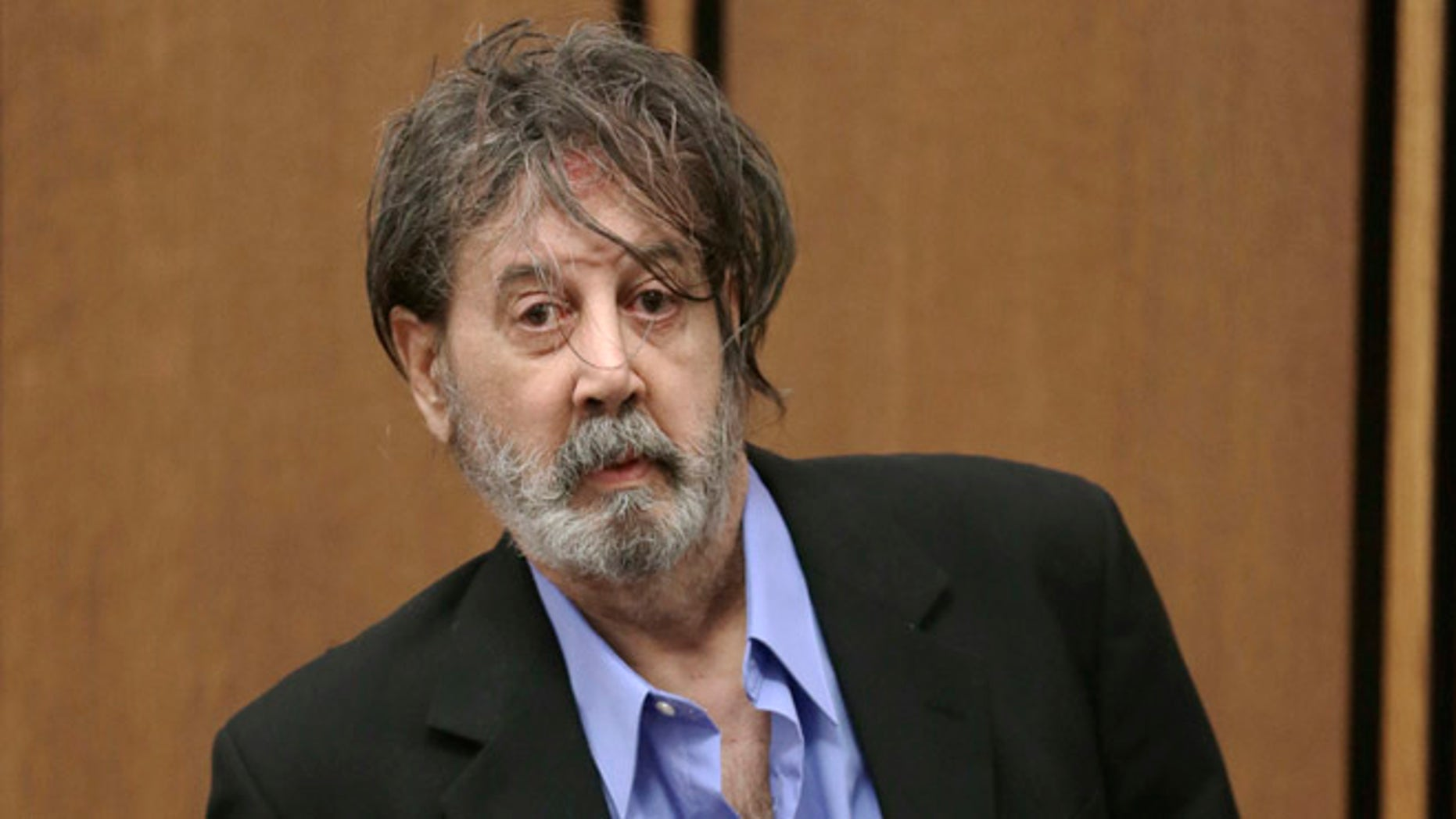 Nov. 13, 2013: Bobby Thompson, who authorities have identified as Harvard-trained attorney John Donald Cody, enters the courtroom in Cleveland.
