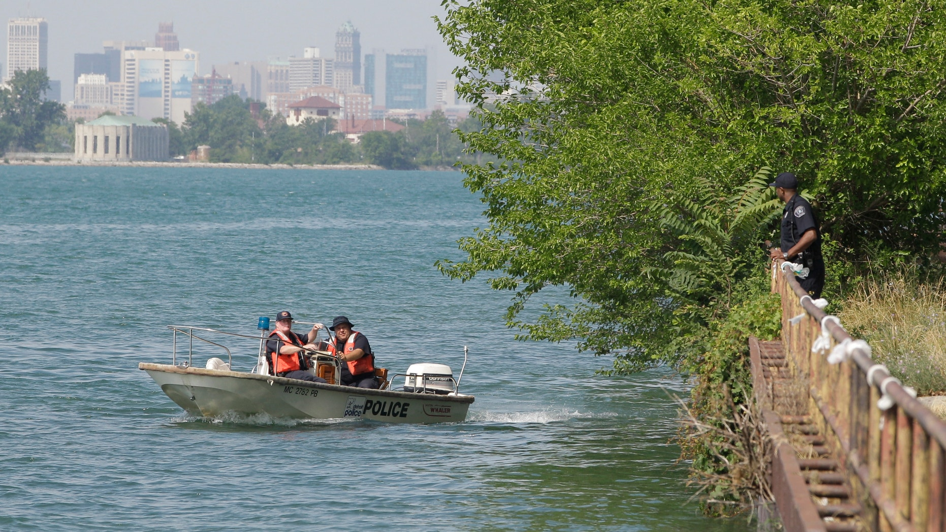 July 17, 2012: Detroit police look over the scene in the Detroit River where the U.S. Coast Guard says the bodies of a man and a woman whose heads, hands and feet were cut off were found floating.