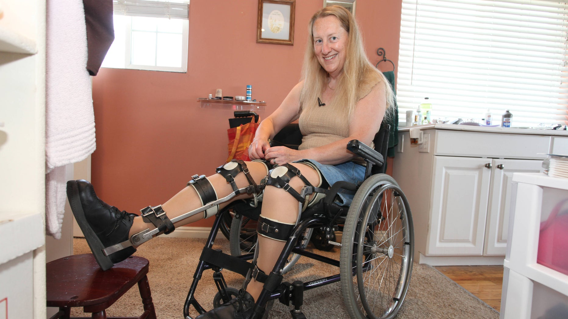 Chloe Jennings-White adjusting her leg braces at her home in Salt Lake City, Utah.  Chloe-Jennings White wears leg braces and uses a wheelchair, even though her legs work fine, and she does not need them.