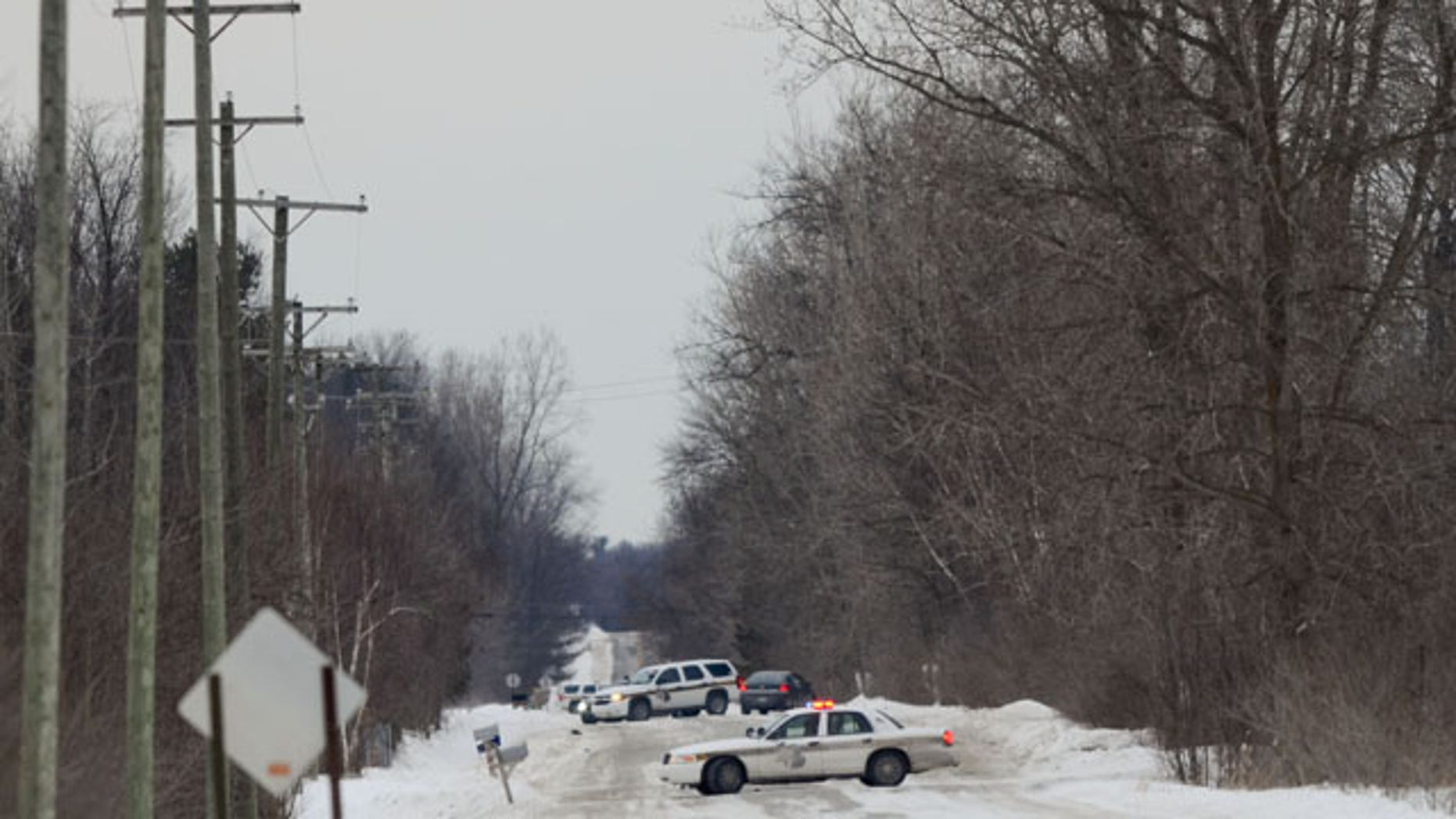 January 30, 2014: Officers from the St. Clair County Sheriff's Department investigate a scene where bags of human remains were discovered at the intersection Allington and Fred Moore Highway in St. Clair Township, Mich. (AP PHOTO/TIMES HERALD, JEFFREY SMITH)
