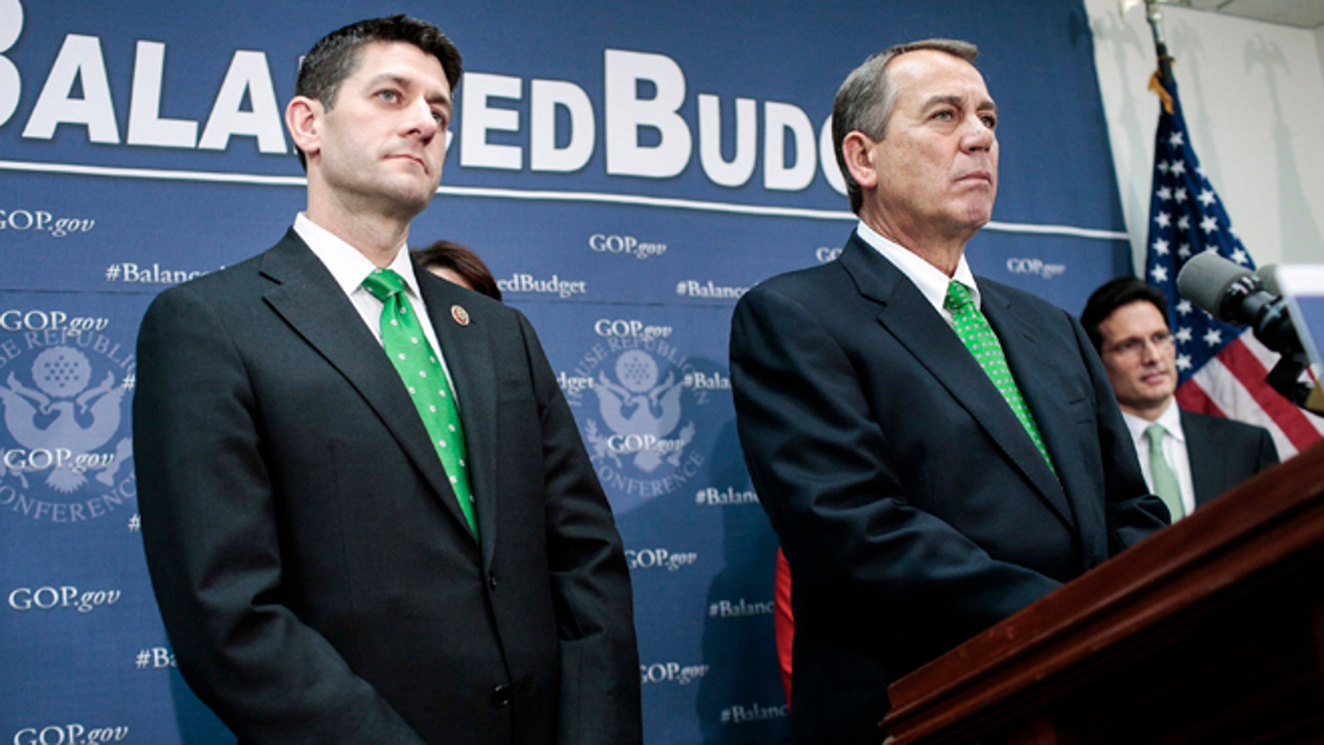 WASHINGTON, DC - MARCH 19: Rep. Paul Ryan (R-WI) (L) and House Speaker John Boehner (R-OH) listen to a question as House Republican leaders address the media after a party conference on March 19, 2013 in Washington, DC. GOP leaders asked that the president work with them to create a balanced budget plan, citing President Clinton's efforts to work with House Republicans on a budget in the 1990s. (Photo by T.J. Kirkpatrick/Getty Images)