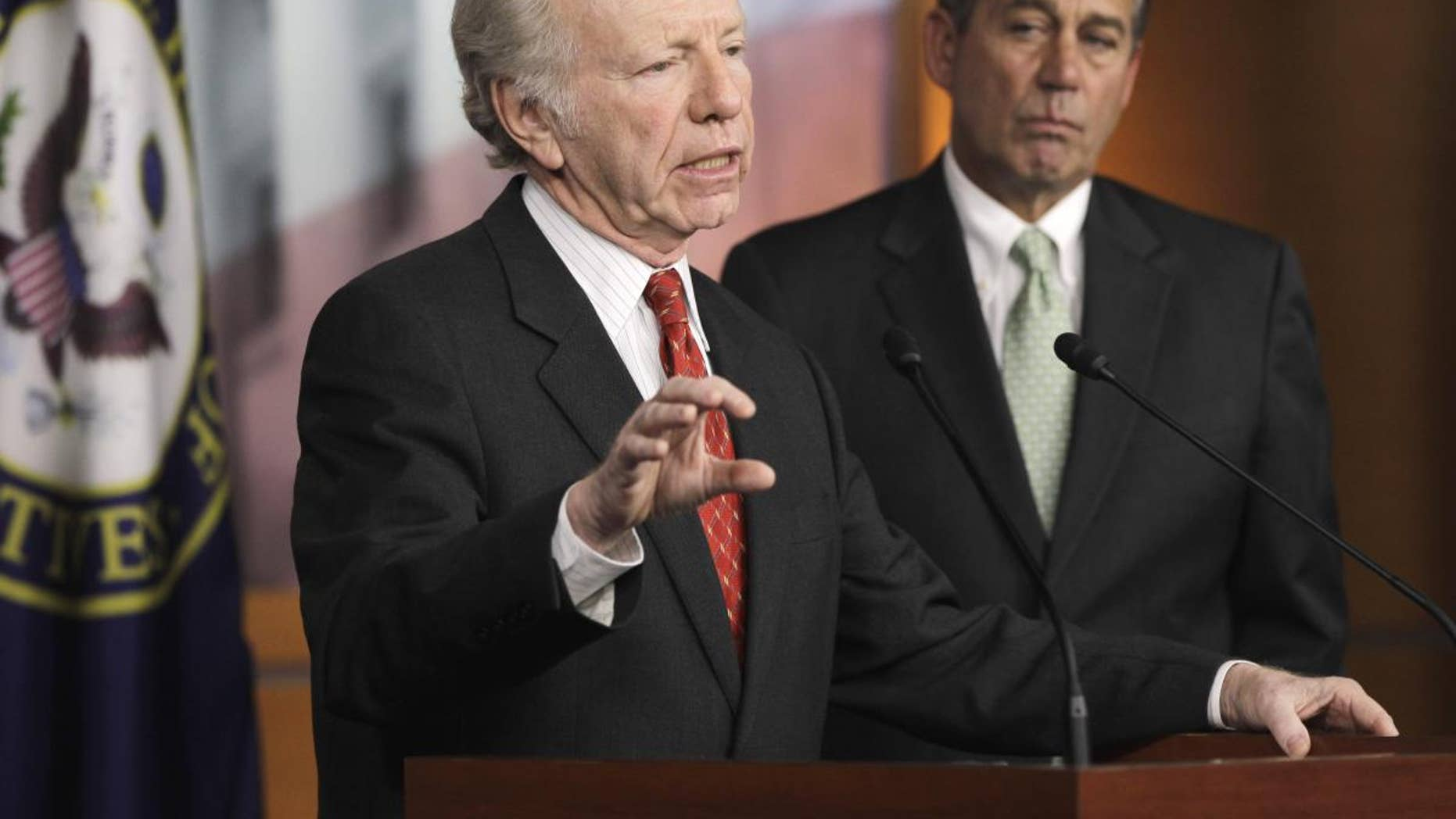 Sen. Joseph Lieberman, I-Conn., left, accompanied by House Speaker John Boehner of Ohio, gestures during a news conference on Capitol Hill in Washington, Wednesday, Jan. 26, 2011, to discuss the introduction of legislation on the DC Opportunity Scholarship Program. (AP Photo/Charles Dharapak)