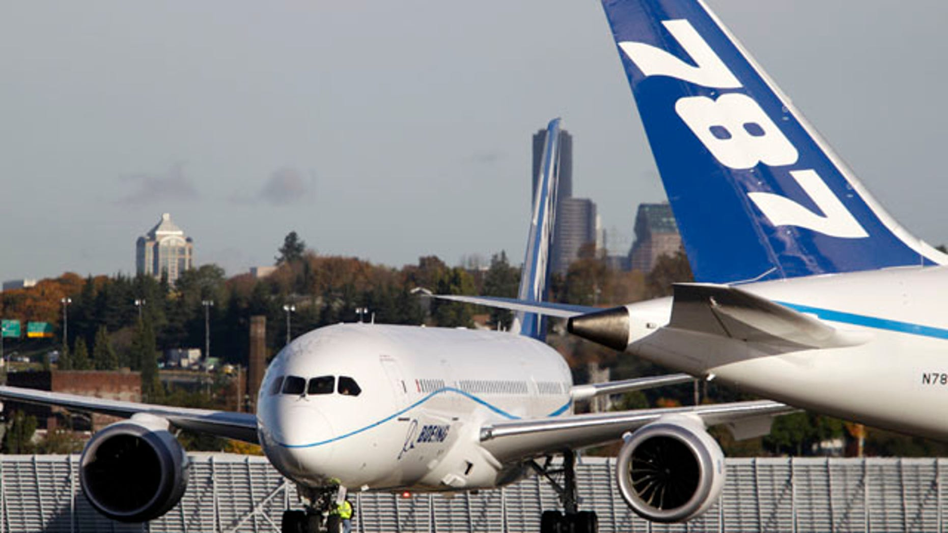 Oct. 27: One test model Boeing 787 passes another on the tarmac before a flight from Boeing Field, in Seattle. Boeing is putting off more test flights of its new 787 passenger jet while it investigates an emergency landing of one of the planes in Texas.
