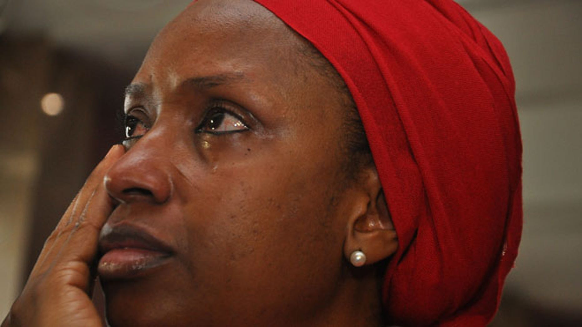 July 8: An unidentified mother of a child that was abducted by Nigerian extremists reacts during an event in the memory of the girls.