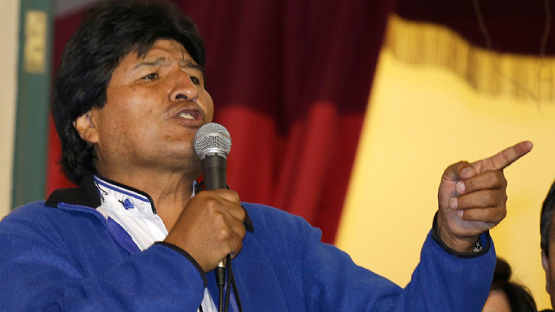 October 12, 2014: Bolivia's President Evo Morales speaks to supporters from the balcony of the presidential palace in La Paz.  (AP Photo/Martin Mejia)