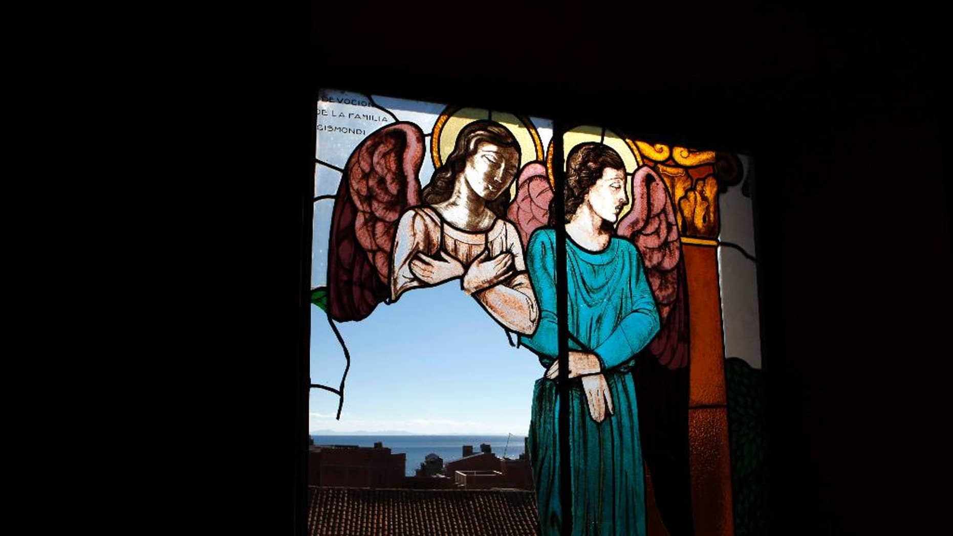April 23, 2013: In this file photo, a stained glass window, broken by thieves according to the local priest, remains damaged at the Basilica of Our Lady of Copacabana in Copacabana, Bolivia. (AP)