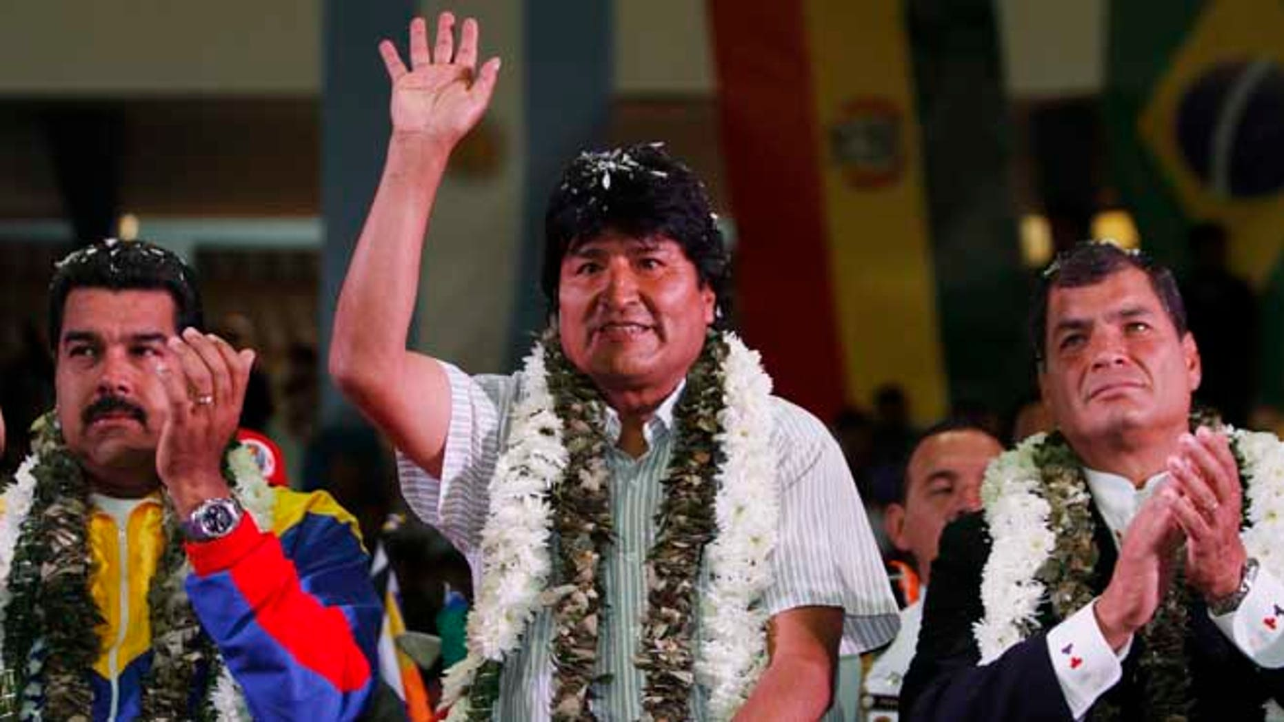 July 4, 2013: Venezuela's President Nicolas Maduro, left, Ecuador's President Rafael Correa, right, and Bolivia's President Evo Morales acknowledge supporters during a welcome ceremony for presidents attending an extraordinary meeting in Cochabamba, Bolivia.