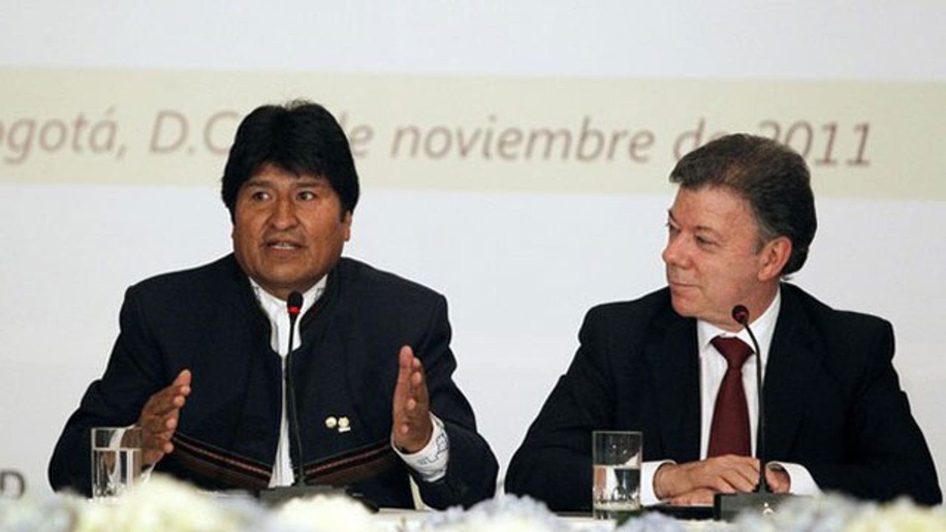 November 8, 2011: Bolivia's President Evo Morales (L) speaks as his Colombian counterpart Juan Manuel Santos listens during an extraordinary meeting of the Andean Community of Nations (CAN) at Narino Palace in Bogota.