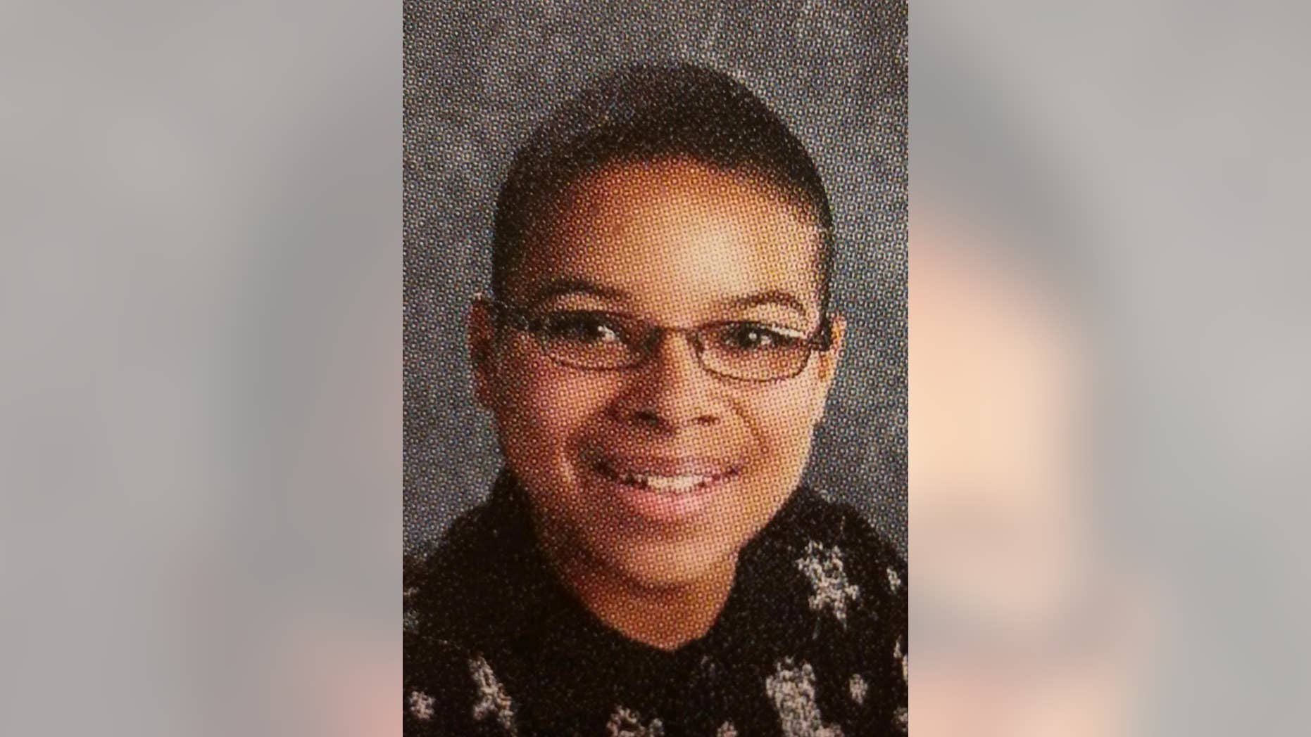This 2010 yearbook photo provided by Topeka Public Schools from a Topeka West High School shows John Booker. Booker, accused of planning a suicide attack at Fort Riley, was arrested Friday, April 10, 2015, while trying to arm what he thought was a bomb near the Kansas military base as part of a plot to support the Islamic State group, federal prosecutors said. (AP Photo/Topeka Public Schools)