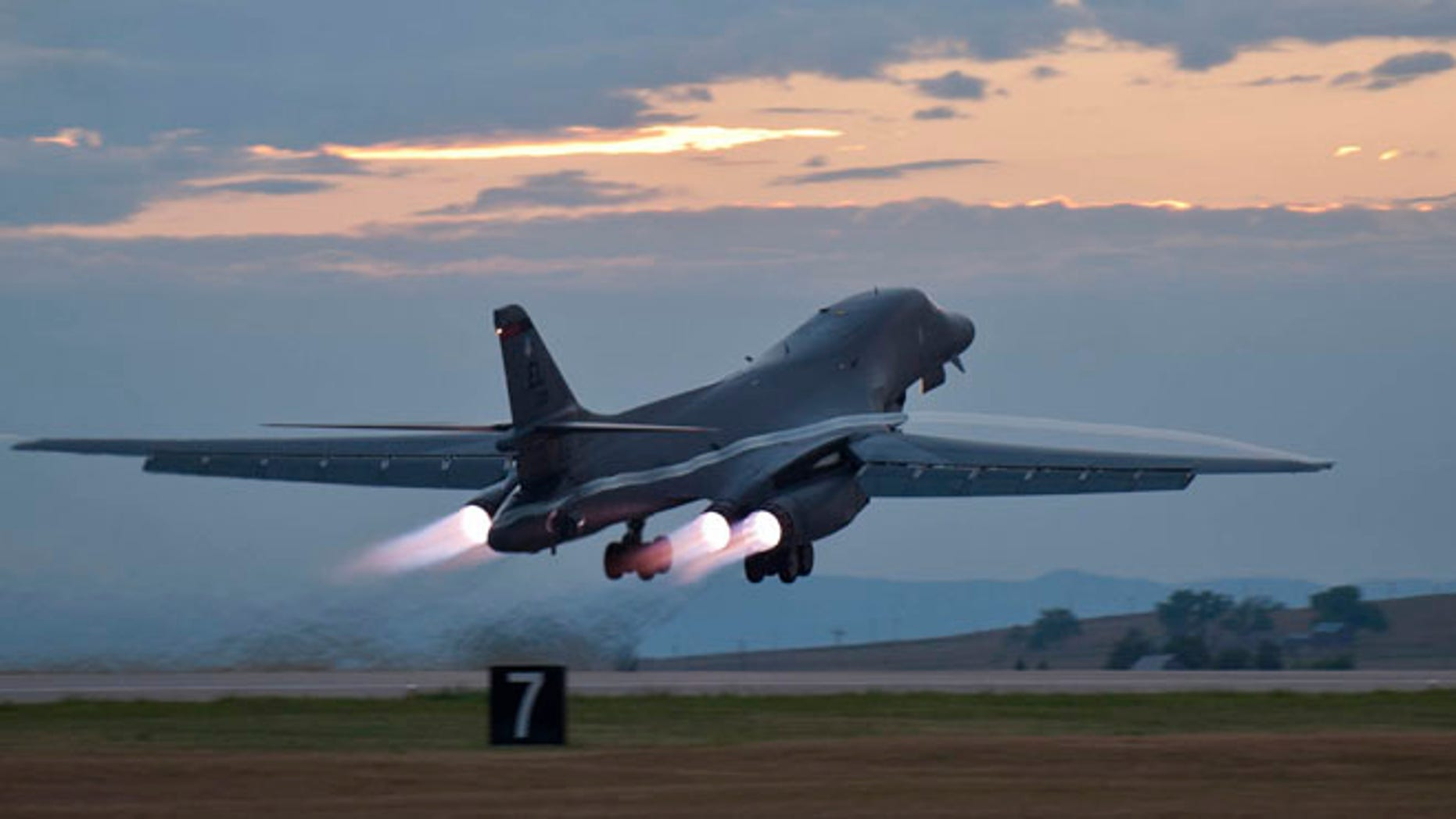 July 24, 2012: An Air Force  B-1 bomber rumbling down the flightline at Ellsworth Air Force Base, S.D., as part of a training mission.