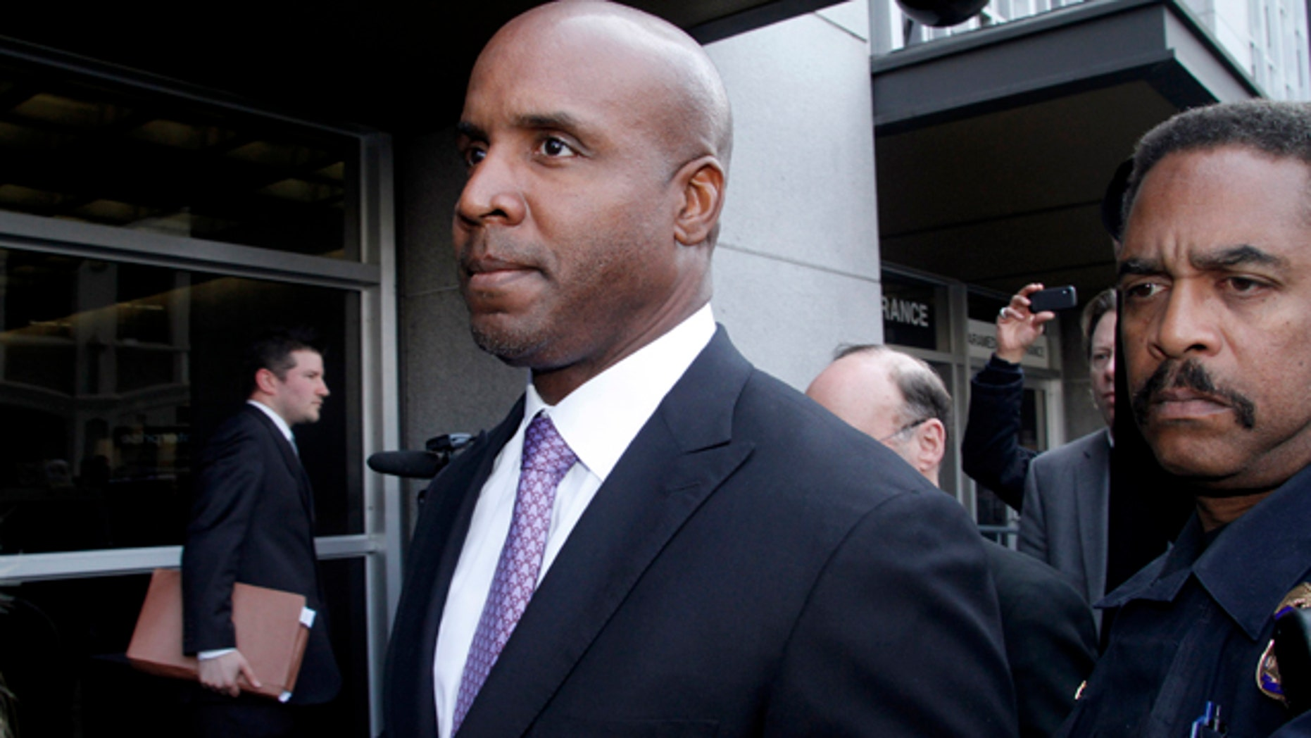FILE - In this April 13, 2011, file photo, former baseball player Barry Bonds leaves federal court in San Francisco, after being found guilty of one count of obstruction of justice. (AP Photo/George Nikitin, File)