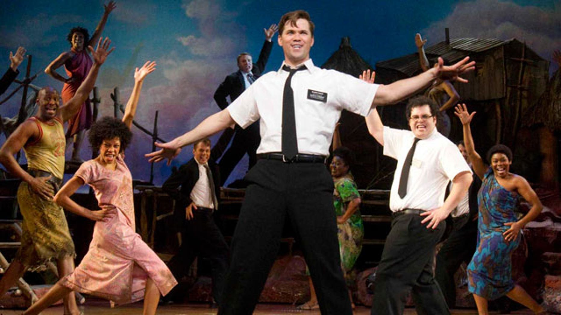 """n this theater publicity image released by Boneau/Bryan-Brown, Andrew Rannells, center, performs with an ensemble cast in """"The Book of Mormon"""" at the Eugene O'Neill Theatre in New York. (AP)"""