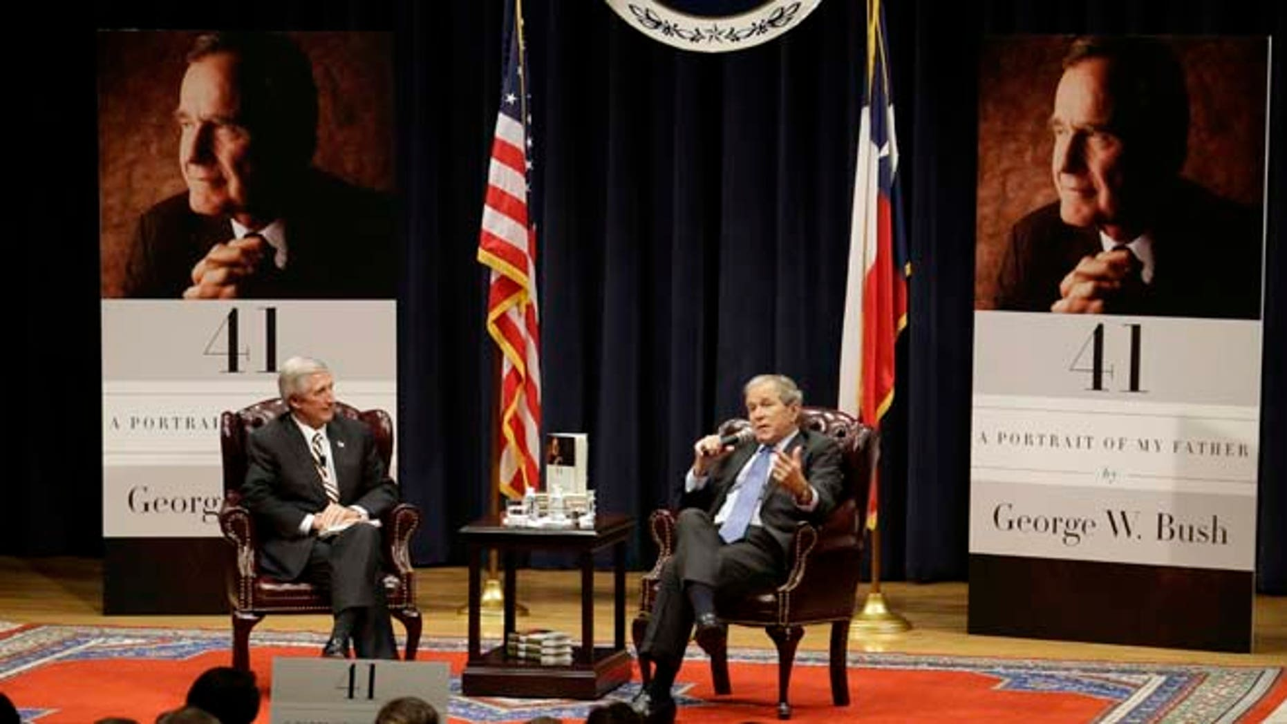 """In this Tuesday, Nov. 11, 2014 photo, former President George W. Bush  discusses his new book """"41: A Portrait of My Father"""" with Andrew Card, his former chief of staff at his father's George H.W. Bush Presidential Library in College Station, Texas."""