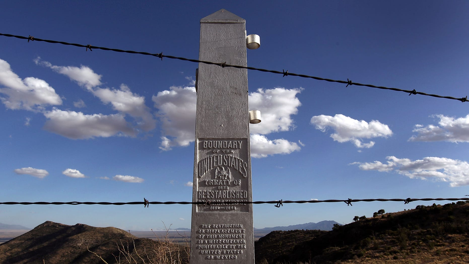 MONTEZUMA PASS, AZ - MAY 02:  An obelisk and a barbed wire fence mark the border between the United States and Mexico on May 2, 2010 at Montezuma Pass, Arizona. Although  the U.S. government has spent billions of dollars constructing border defenses in the last decade, critics say that Arizona's border with Mexico was left with less protection, compared with California and Texas. Proponents of Arizona's new immigration enforcement law say that federal inaction led to passage of the law, which has raised fears of racial profiling by police against Latinos. (Photo by John Moore/Getty Images)