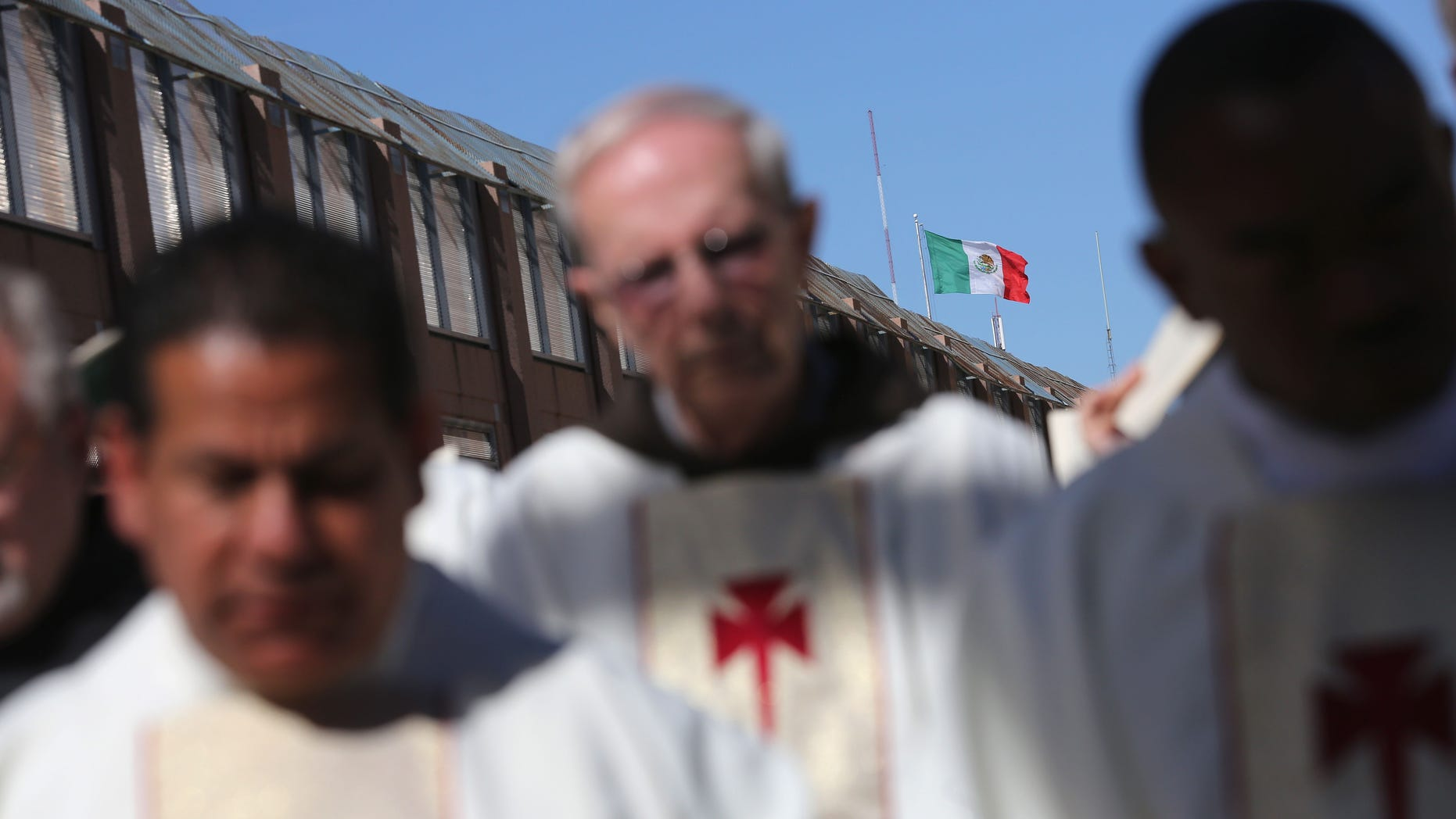 NOGALES, AZ - APRIL 01:  Catholic clergy pray during a special 'Mass on the Border' on April 1, 2014 in Nogales, Arizona. Catholic bishops led by the Archbishop of Boston Cardinal Sean O'Malley held the mass at the U.S.-Mexico border fence to pray for comprehensive immigration reform and for those who have died along the border.  (Photo by John Moore/Getty Images)