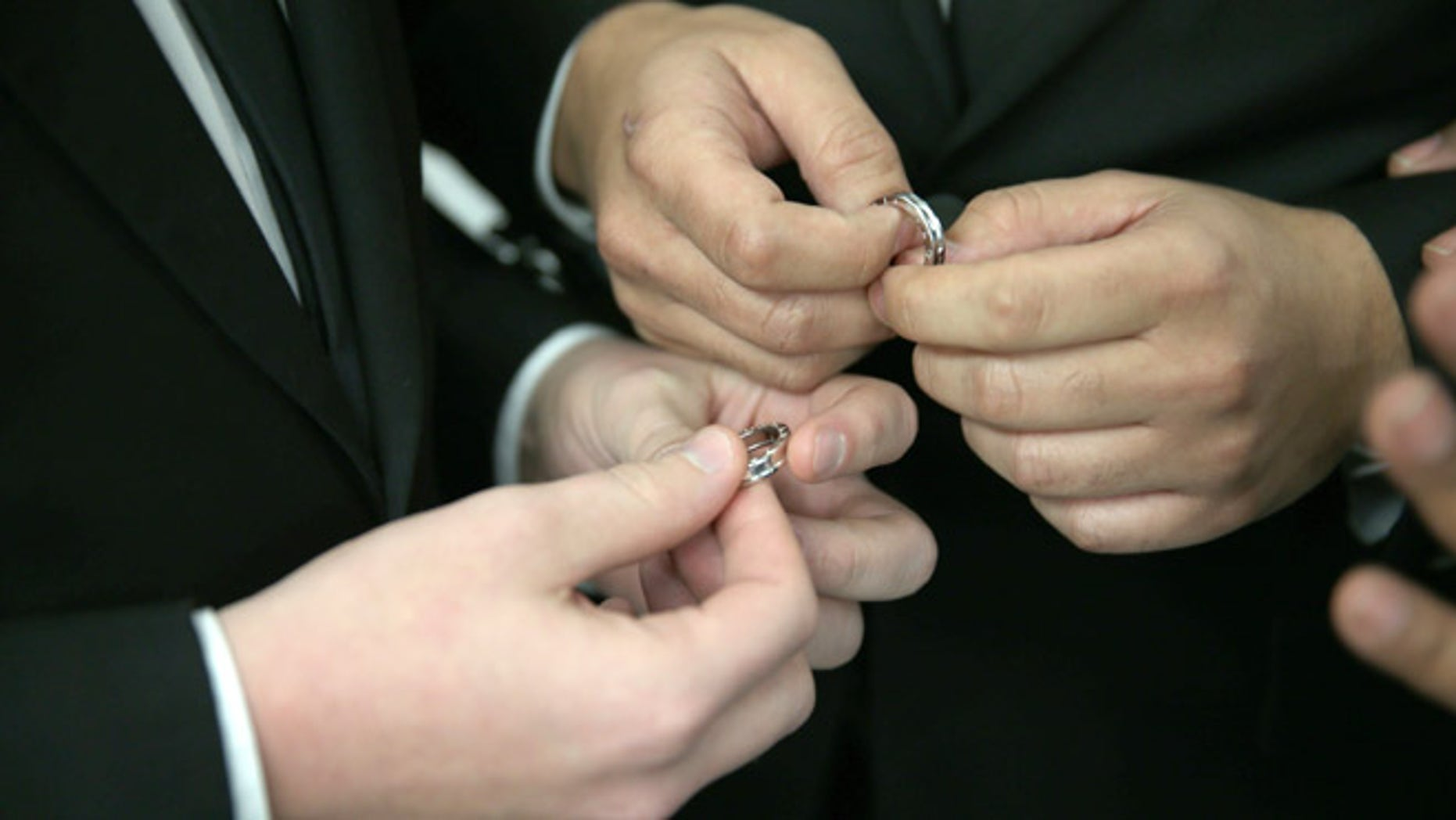 FORT LAUDERDALE, FL - JANUARY 06:  A couple exchange rings as they are wed during a wedding ceremony at the Broward County Courthouse on January 6, 2015 in Fort Lauderdale, Florida. Gay marriage is now legal statewide after the courts ruled that the ban on gay marriage is unconstitutional and the Supreme Court declined to intervene.  (Photo by Joe Raedle/Getty Images)