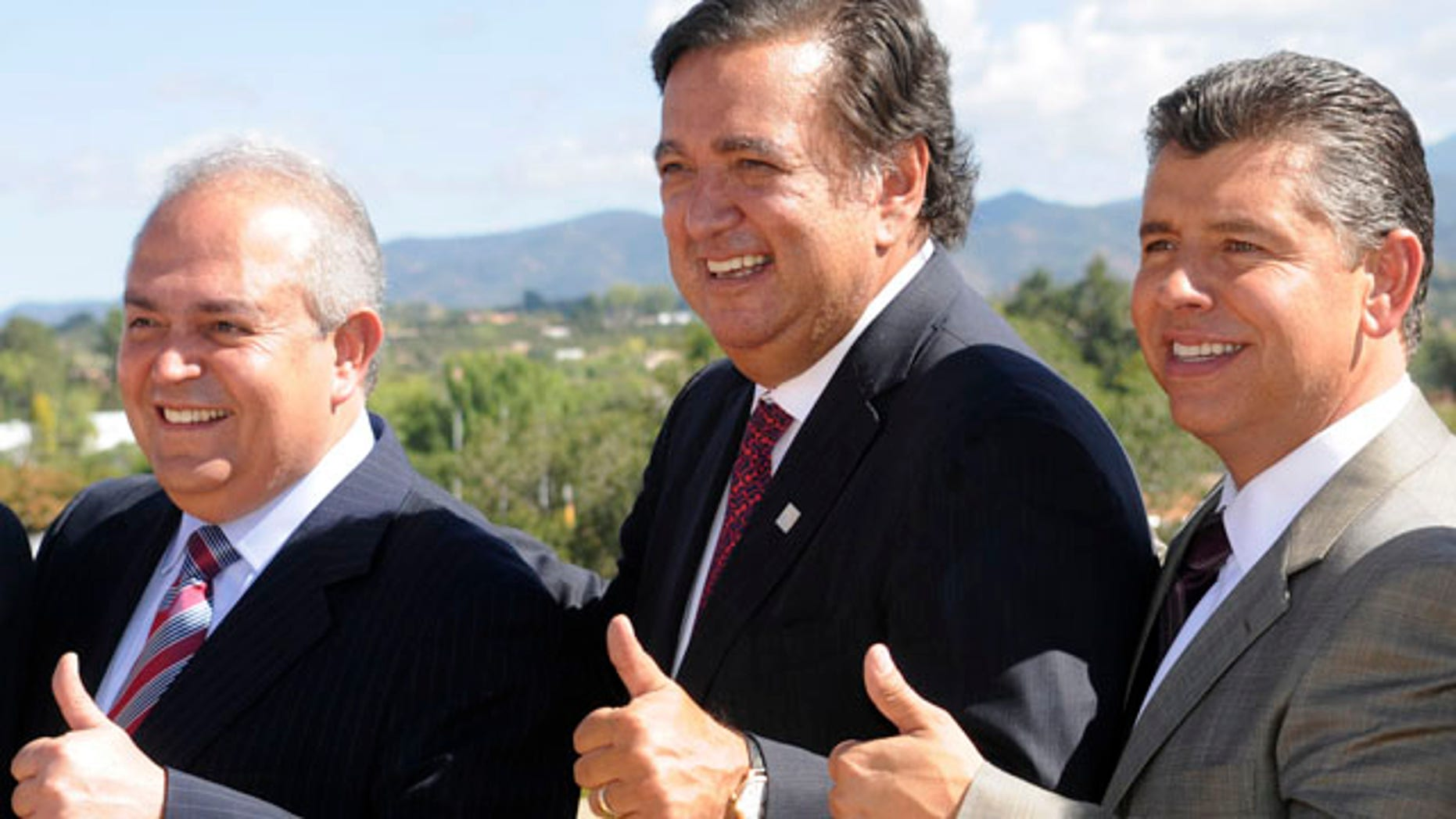 Baja California Governor Jose Guadalupe Osuna Millan, left, New Mexico Governor Bill Richardson, center, and Lt. Governor of California Abel Maldonado pose for photos at the 2010 Border Governors Conference in Santa Fe, New Mexico on Monday Sept. 20, 2010. (AP Photo/Dean Hanson, Pool)