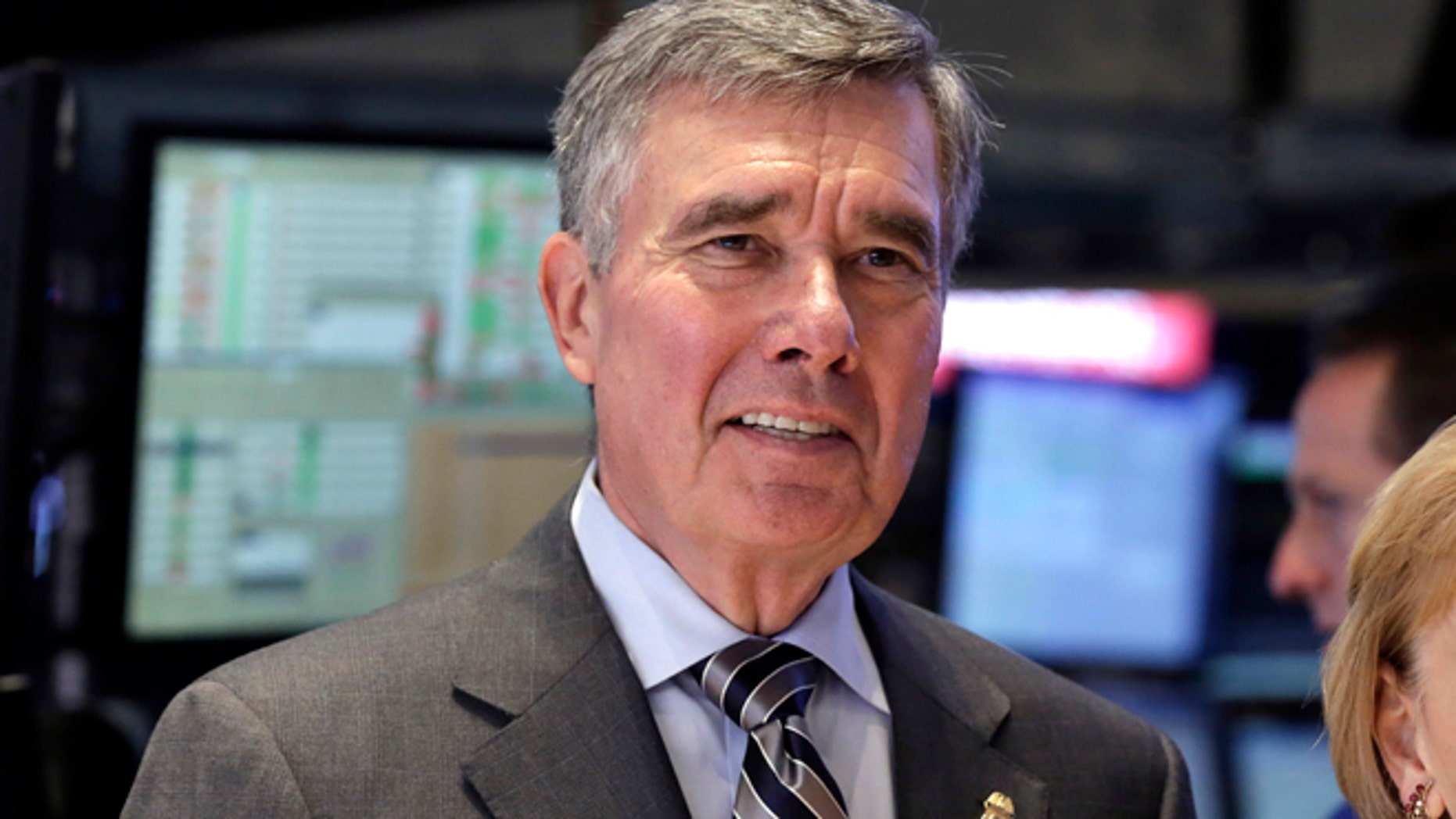 FILE - U.S. Customs and Border Protection Commissioner R. Gil Kerlikowske poses for photos after ringing the New York Stock Exchange closing bell, Tuesday, Aug. 5, 2014 file photo. Kerlikowske scheduled a news conference Thursday Sept. 18, 2014 in Washington to discuss what his office said were âdevelopments toward CBPâs commitment to increase transparency and accountability.â (AP Photo/Richard Drew, File)