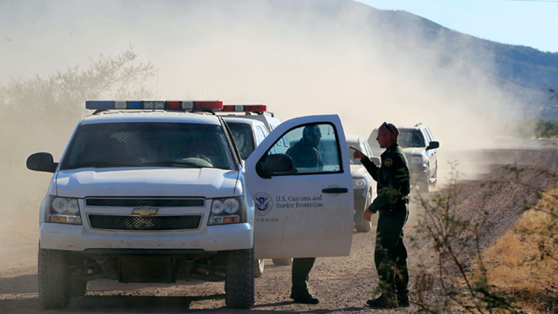 FILE - In this Oct. 2, 1012 file photo, U.S. Customs and Border Protection officers and other law enforcement jurisdictions drive the roads near near Bisbee, Ariz. New Homeland Security Secretary Jeh Johnson is reviewing the department's use of force policies, a Homeland Security official said Friday. The official said Johnson has been reviewing the rules about when agents along the border can use their guns since he took office in December. (AP Photo/Ross D. Franklin, file)