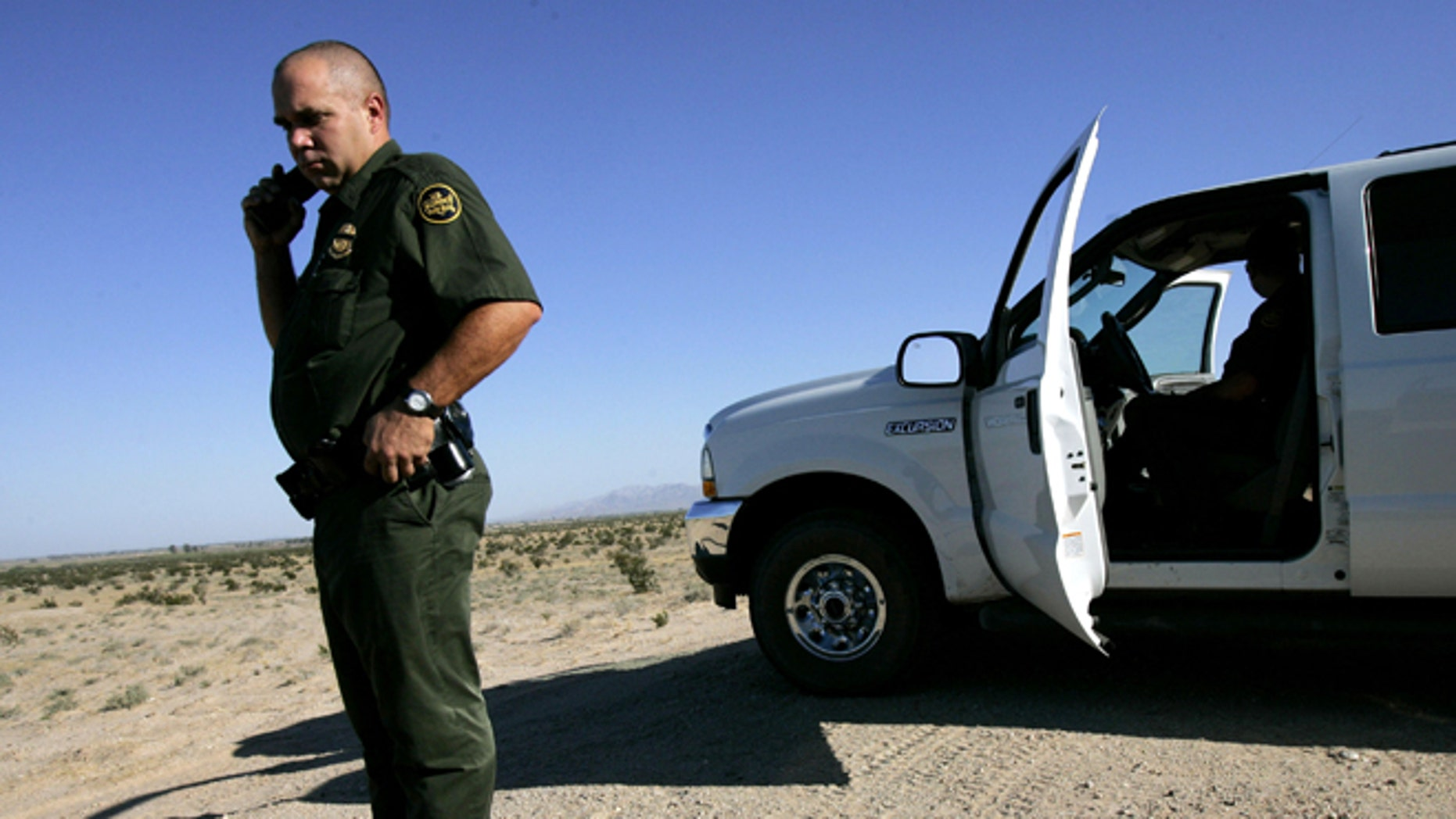 EL CENTRO, CA - AUGUST 29:  Border Patrol agent, Scott Plesuk, patrols the border in the desert August 29, 2005 near El Centro, California. The governors of New Mexico and Arizona have declared a state of emergency along the border due to drug trafficking, illegal immigration and threat of terrorists coming through Mexico.  (Photo by Sandy Huffaker/Getty Images)
