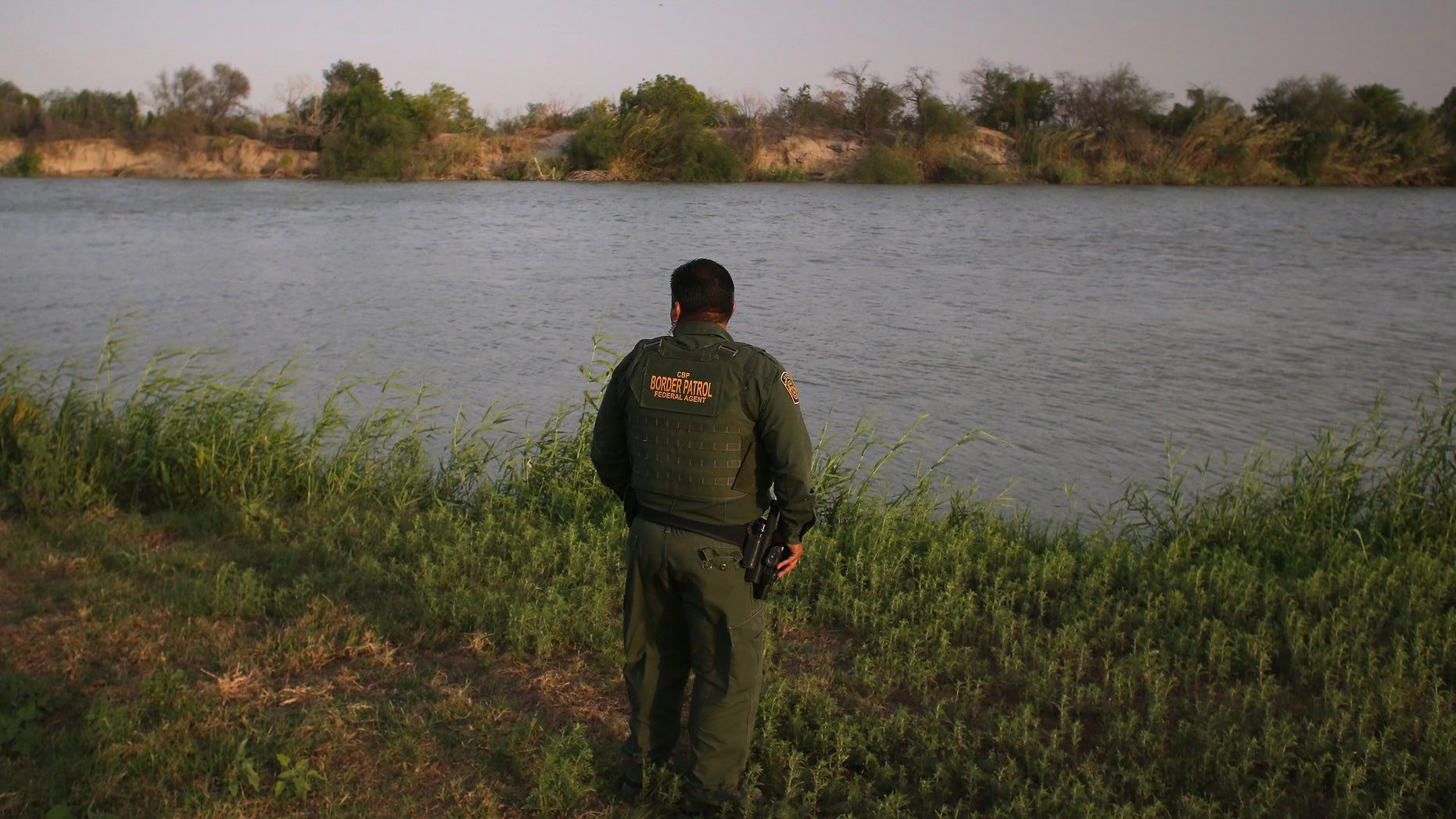 MCALLEN, TX - APRIL 10:  U.S. Border Patrol agent Sal De Leon looks across the Rio Grande River into Mexico at the U.S.-Mexico border while on patrol on April 10, 2013 in McAllen, Texas.  (Photo by John Moore/Getty Images)