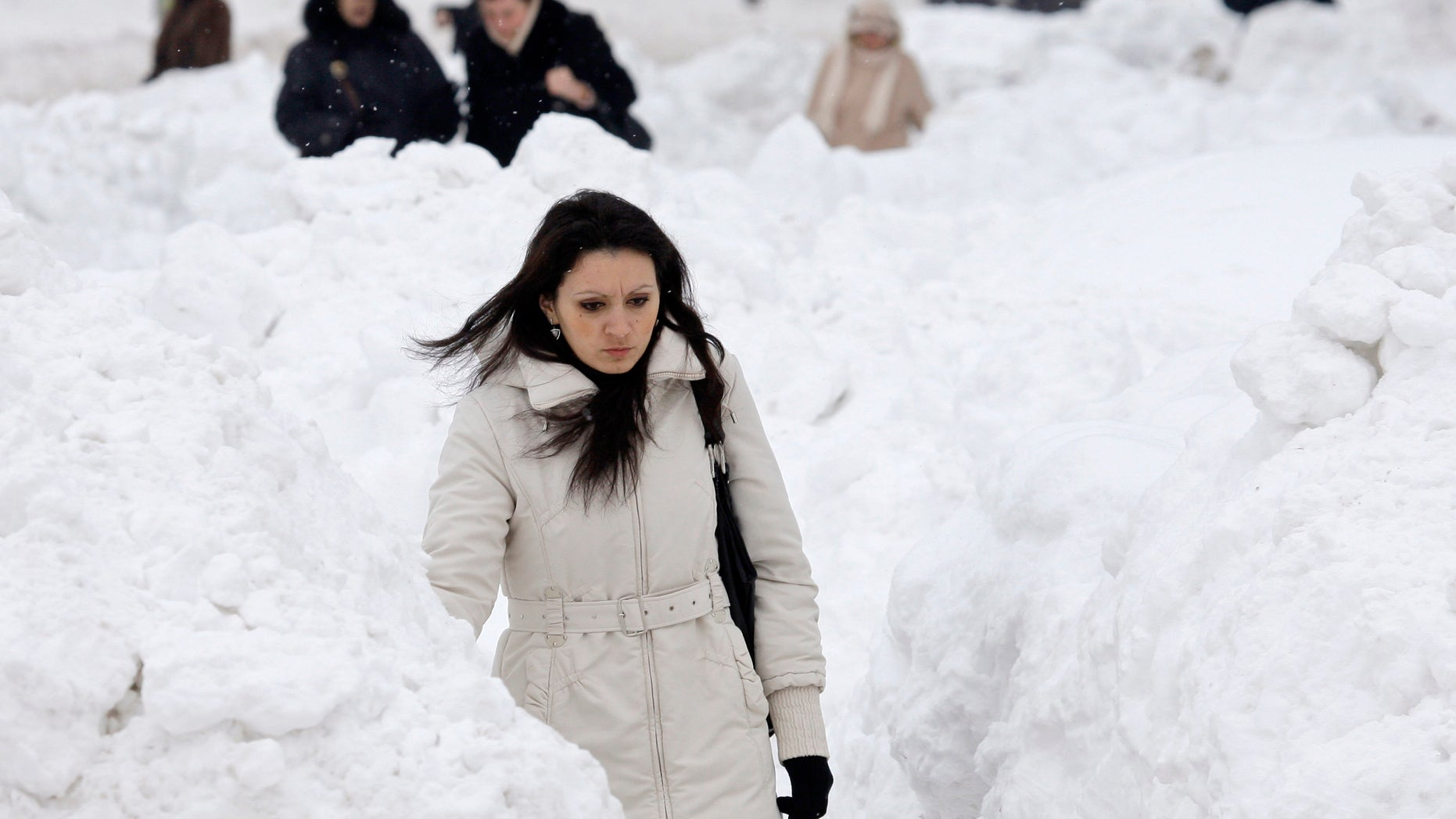 Feb. 6, 2012: A woman makes her way through a snow covered street in Sarajevo.