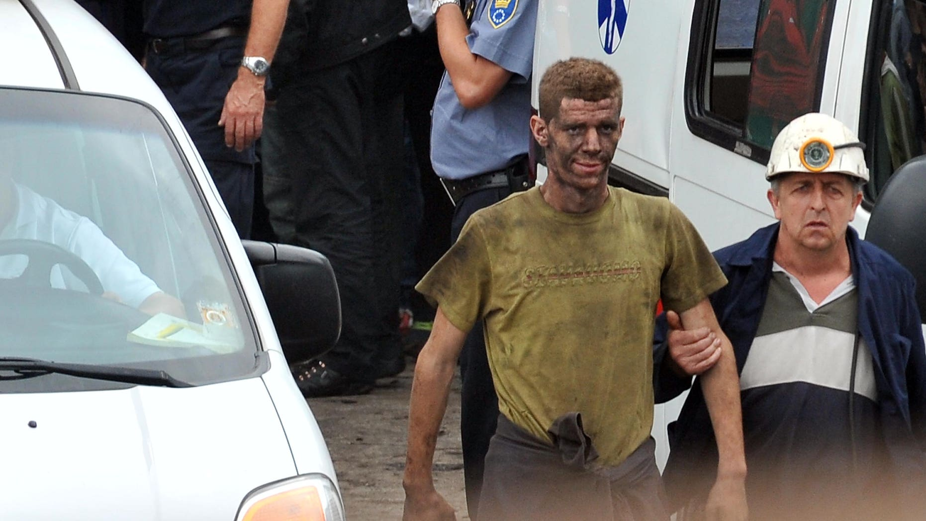 Sept. 5, 2014 - Coal miners help a fellow miner who was injured while trapped in the Raspotocje coal mine in Zenica, north of Sarajevo, Bosnia. Rescuers pulled out some of the 34 miners who had been trapped deep inside the collapsed coal mine, 1,600 feet below ground.