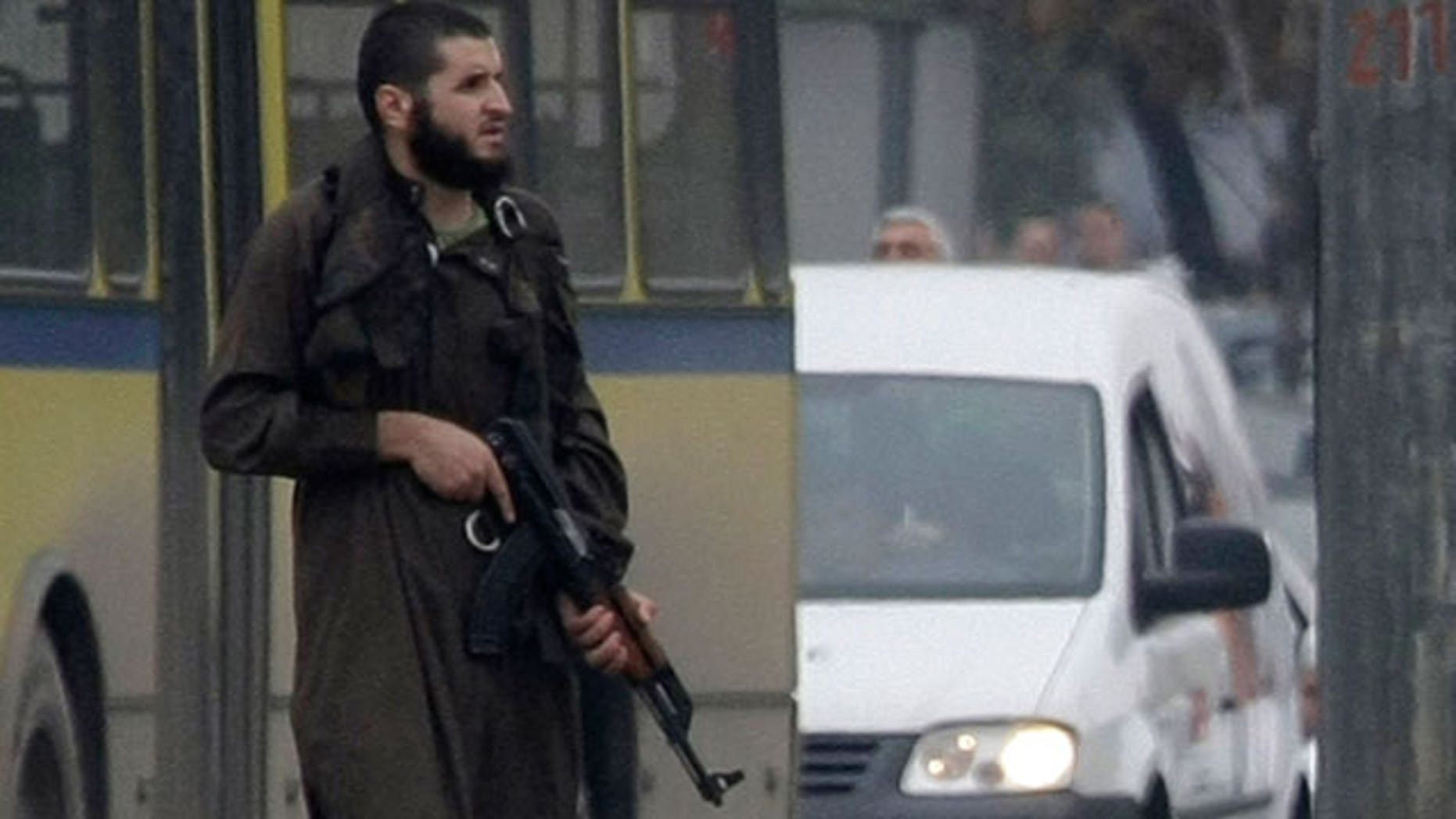Oct. 28: 2011: An unidentified gunman stands in the center of the street in Sarajevo, Bosnia on a street in front of the U.S. embassy. An unidentified man shot several rounds at pedestrians in downtown Sarajevo on Friday and injured at least one officer before police special forces took him down.