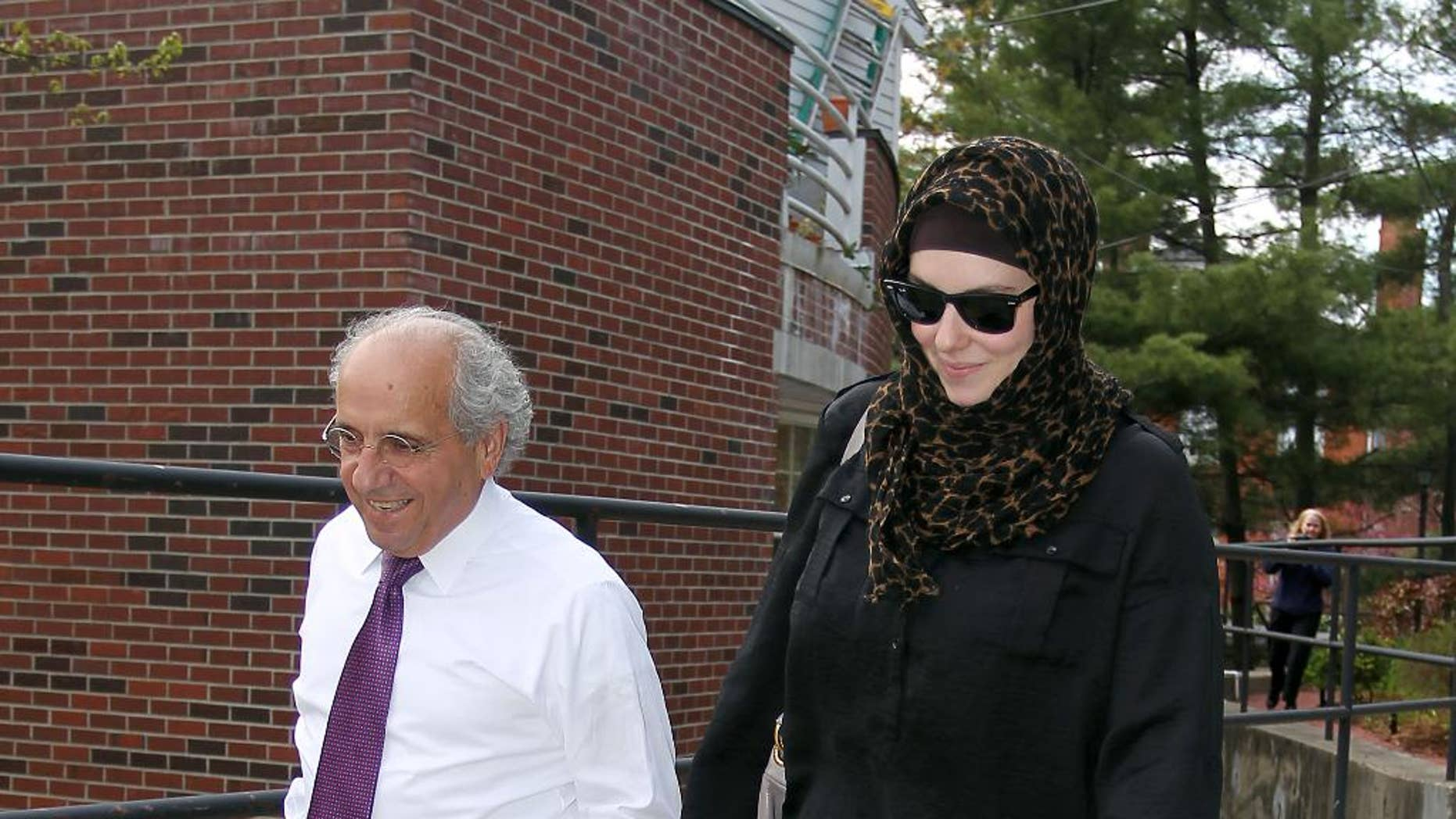 FILE - In this April 29, 2013, file photo, Katherine Russell, right, wife of Boston Marathon bomber suspect Tamerlan Tsarnaev, leaves the law office of DeLuca and Weizenbaum with Amato DeLuca, left, in Providence, R.I. DeLuca tells The Associated Press on Wednesday, March 4, 2015, that he and his client, Russell, have not heard from federal officials since nearly a year ago, shortly before last year's Boston Marathon. DeLuca says they have not been contacted by the defense. (AP Photo/Stew Milne, File)