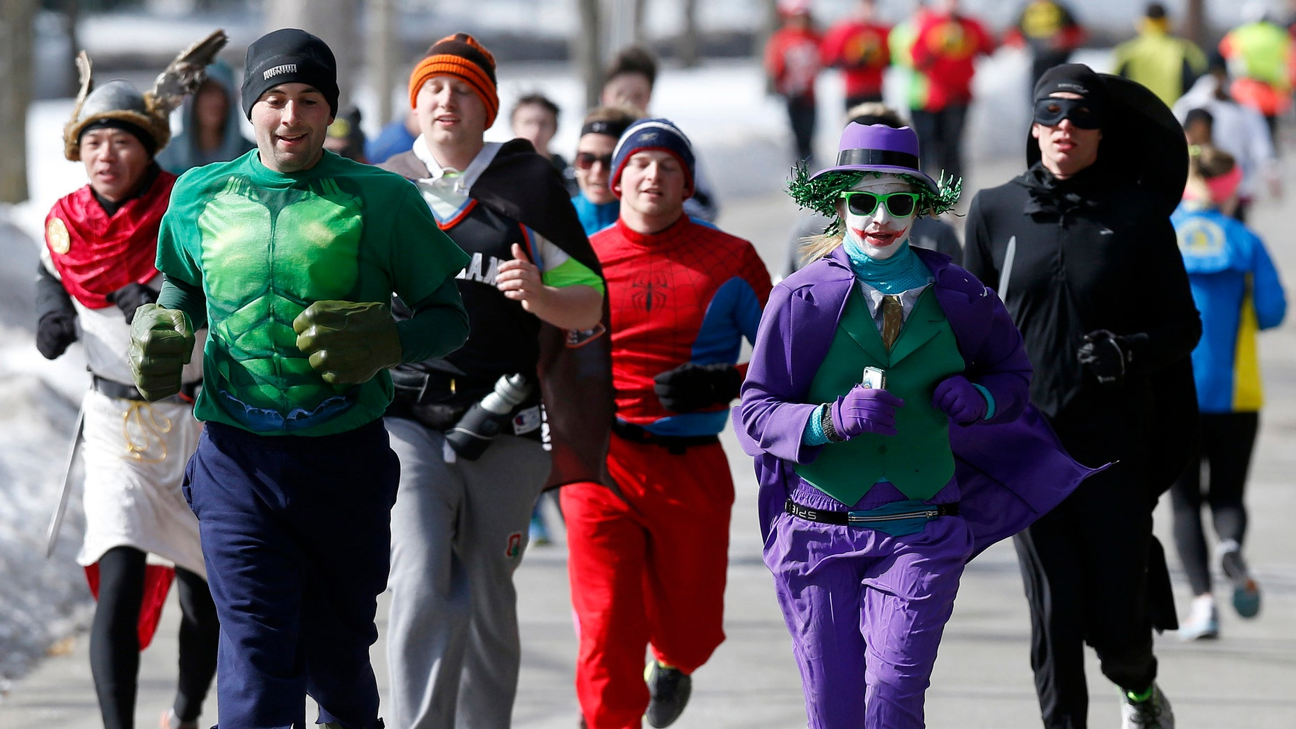 Runners in costume train for the Boston Marathon in Newton, Mass., Saturday, March 1, 2014. People running this year's Boston Marathon for charity gathered for a 17-mile training run along the last 17 miles of the course. (AP Photo/Michael Dwyer)