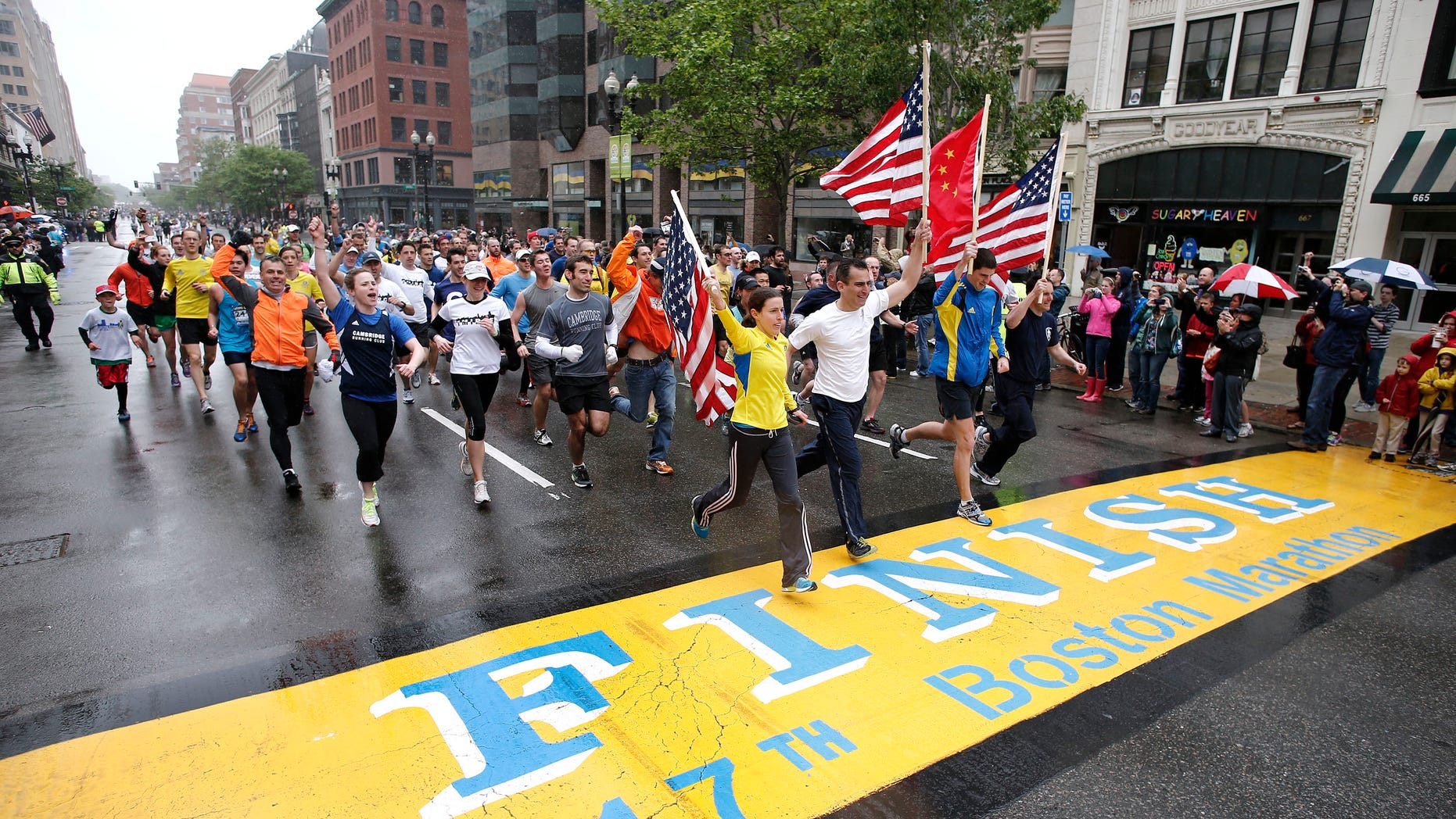 May 25, 2013: Runners who were unable to finish the Boston Marathon on April 15 because of the bombings cross the finish line on Boylston Street after the city allowed them to finish the last mile of the race in Boston.