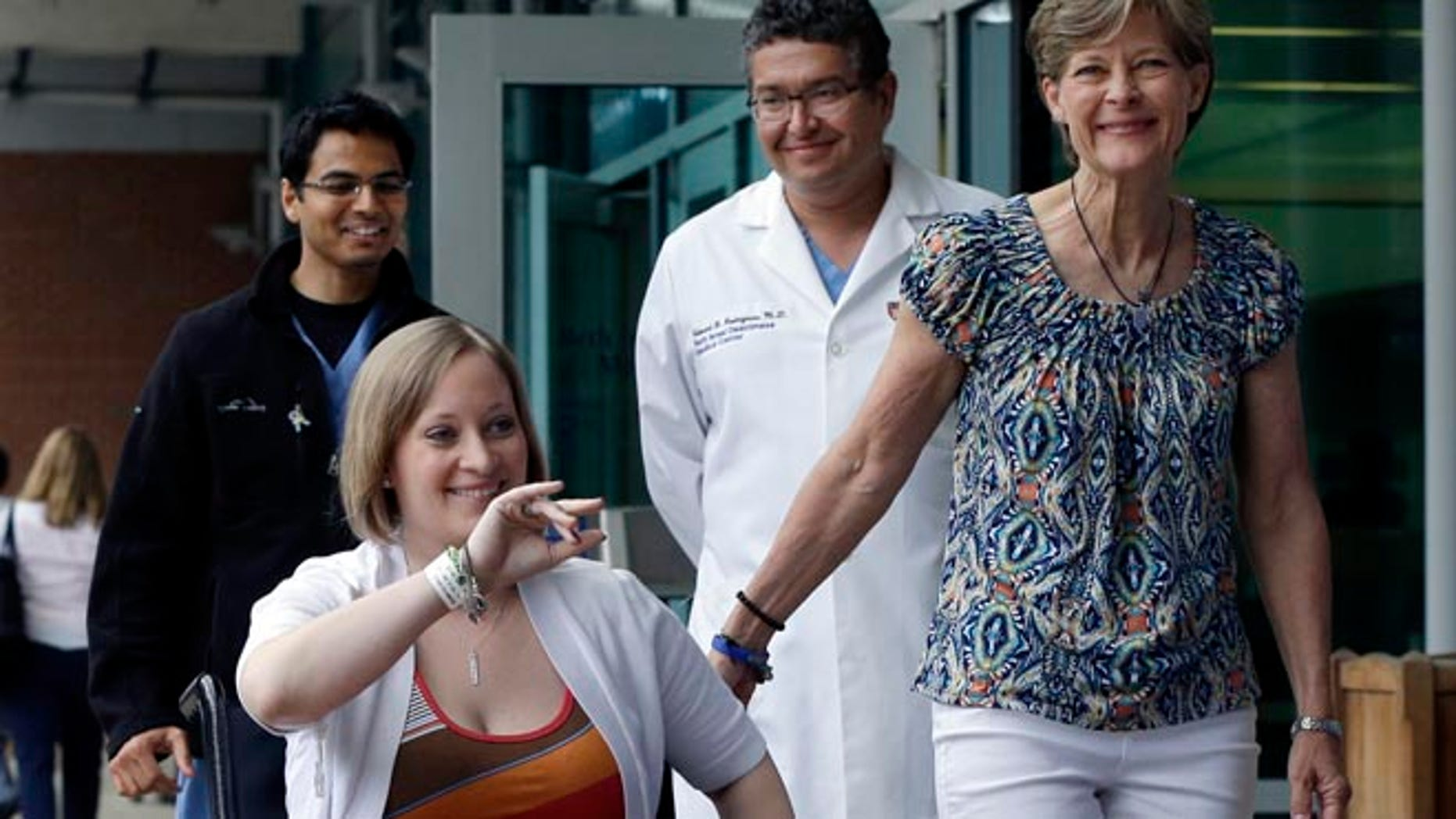 June 3: Erika Brannock, 29, a Baltimore area pre-school teacher who lost a leg in the Boston Marathon bombings, is accompanied by her mother, Carol Downing, right, as she is released from Beth Israel Deaconess Medical Center.