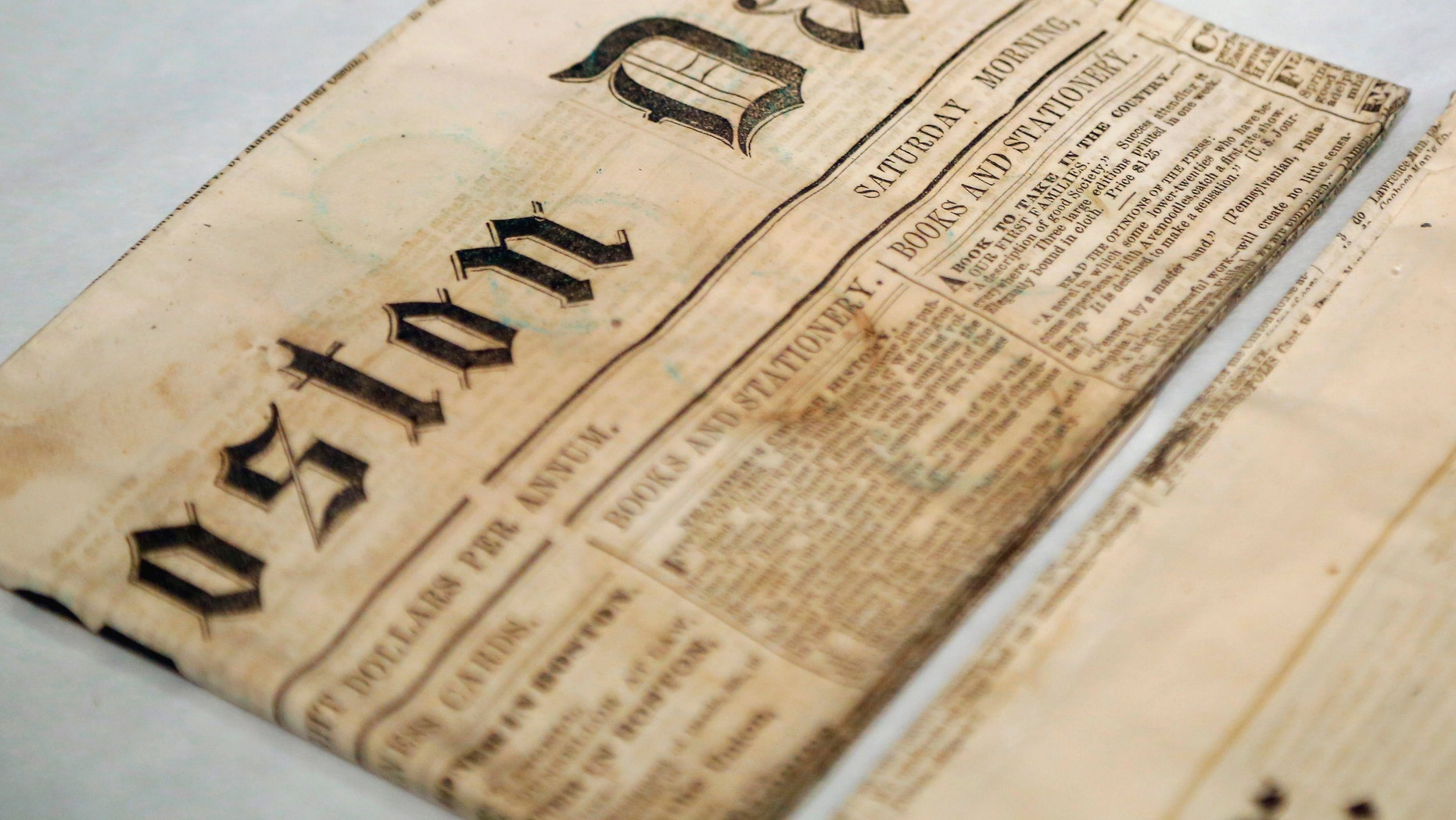 Newspapers removed from a time capsule, which was placed under a cornerstone of the State House in 1795, sit in archival boxes at the Museum of Fine Arts, Boston, Massachusetts, January 6, 2015.