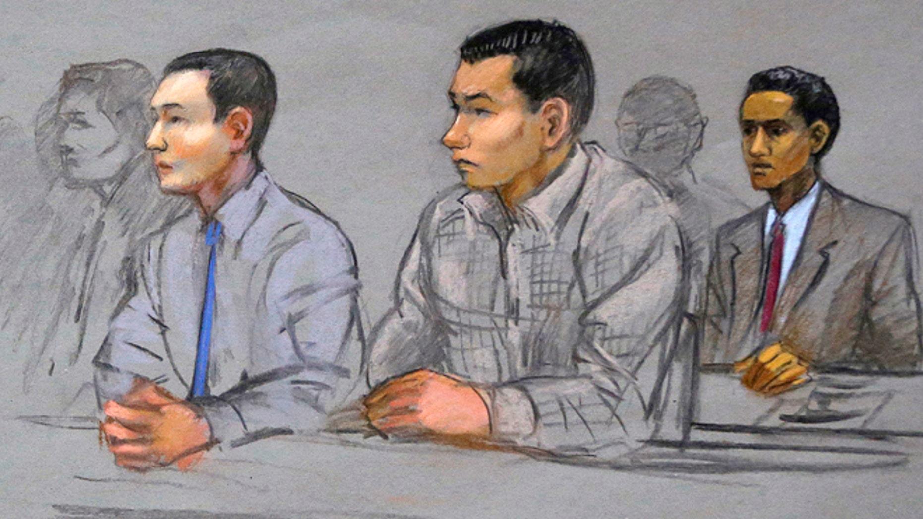FILE courtroom sketch: Defendants Azamat Tazhayakov, left, Dias Kadyrbayev, center, and Robel Phillipos, right, college friends of convicted Boston Marathon bomber Dzhokhar Tsarnaev, sit during a hearing in federal court in Boston.