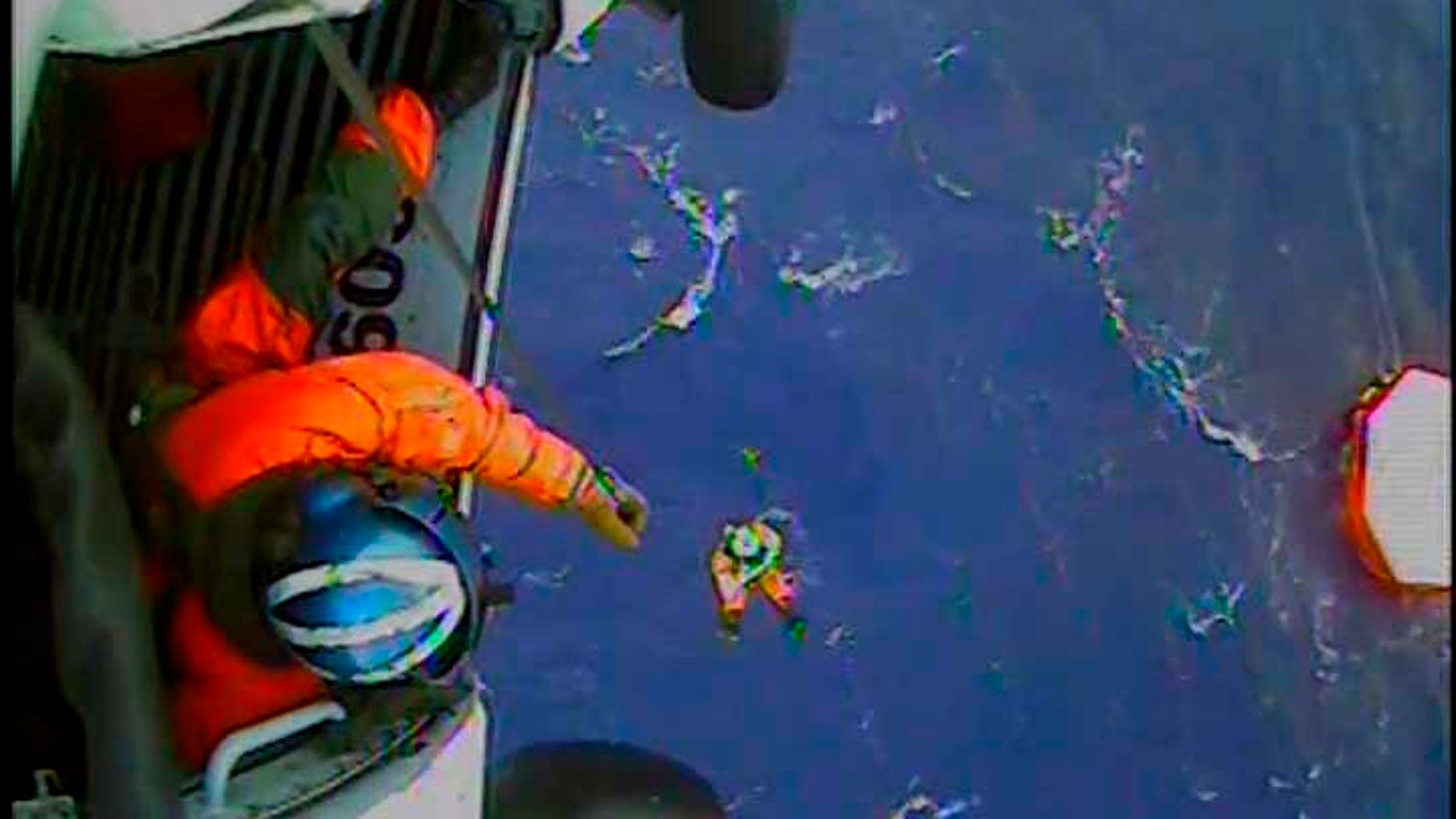 Oct. 29, 2012: A member of the U.S. Coast Guard is lowered to a life raft in the Atlantic Ocean approximately 90 miles southeast of Hatteras, North Carolina.  The U.S. Coast Guard rescued 14 of the 16 crew who abandoned the HMS Bounty while in the path of Hurricane Sandy off North Carolina, using helicopters to lift them from life rafts, the Coast Guard said.