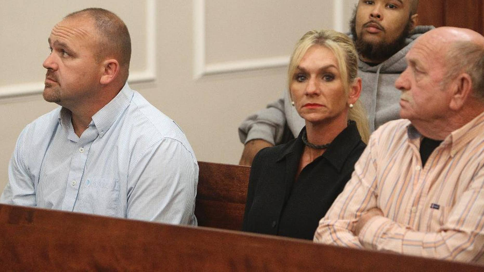 "From left, Gilbert ""Toby"" Curtsinger, his wife, Julie Curtsinger, and her father Robert McKinney sit together in Franklin County Circuit Court in Frankfort, Ky on Friday, May 22, 2015. The Curtsingers pleaded not guilty to multiple charges Friday. Both are charged with engaging in organized crime.   McKinney, also facing charges, pleaded not guilty  (Michael Clevenger/The Courier-Journal via AP) NO SALES; MAGS OUT; NO ARCHIVE; MANDATORY CREDIT"