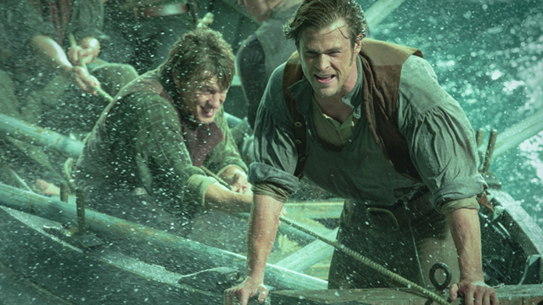 This photo provided by Warner Bros. Pictures shows, Chris Hemsworth, right, as Owen Chase, and Sam Keeley as Ramsdell, left, in a scene from the film 'In the Heart of the Sea.' (Jonathan Prime/Warner Bros. Pictures via AP)