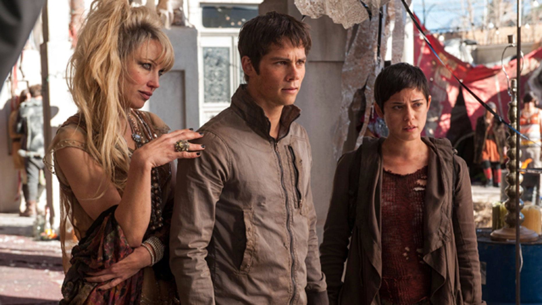 In this image released by 20th Century Fox, Jenny Gabrielle, from left, Dylan OBrien and Rosa Salazar appear in a scene from the film, 'Maze Runner: The Scorch Trials.' (Richard Foreman, Jr./20th Century Fox via AP)