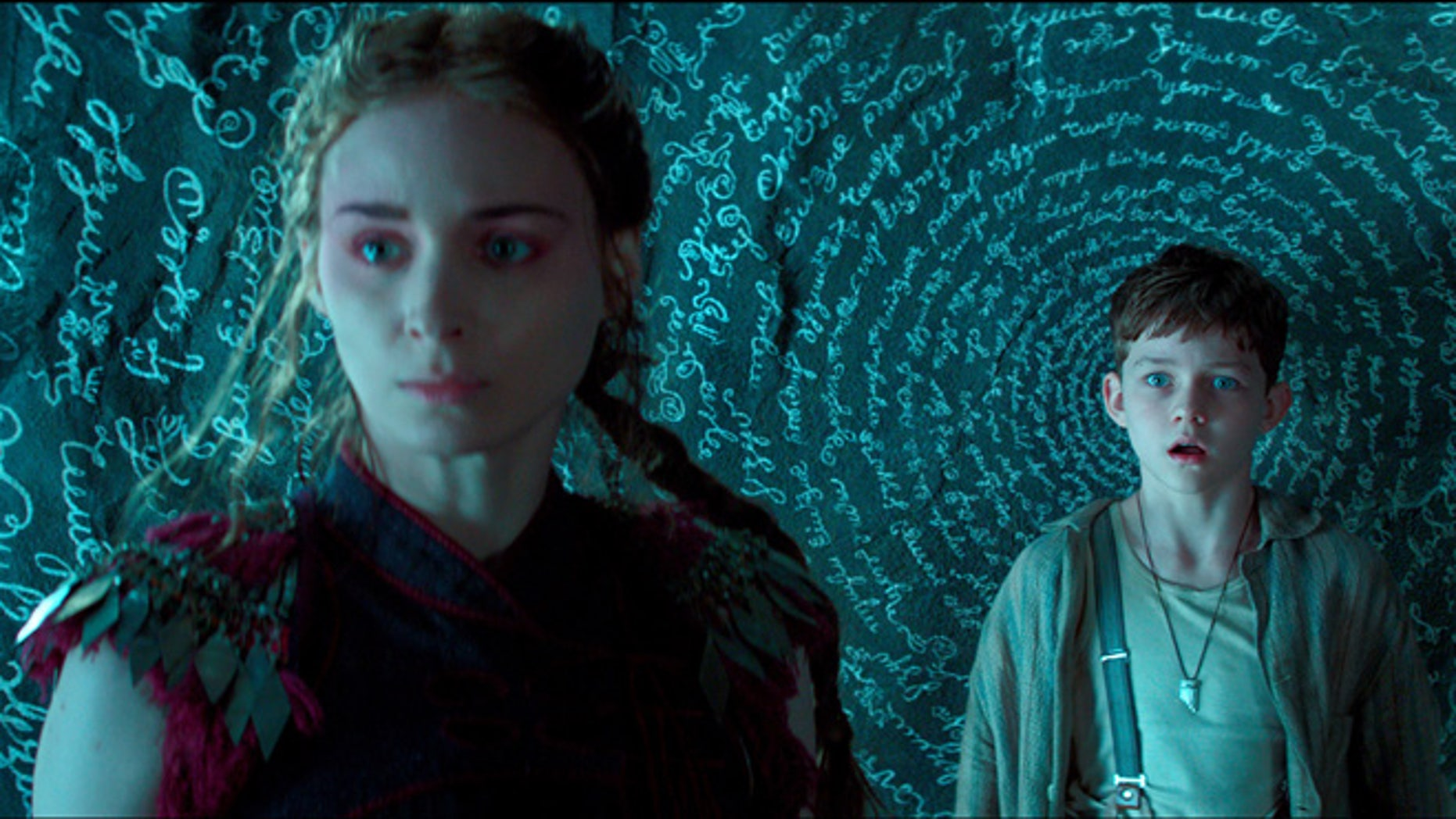 """This photo provided by courtesy of Warner Bros. Pictures shows, Rooney Mara, left, as Tiger Lily, and Levi Miller as Peter, in a scene from the film, """"Pan."""""""