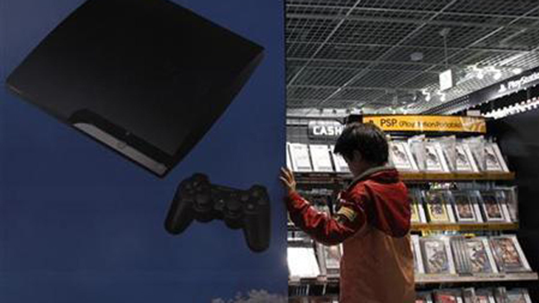 A boy chooses Sony's Playstation game software at an electronic shop in Tokyo May 5, 2011.