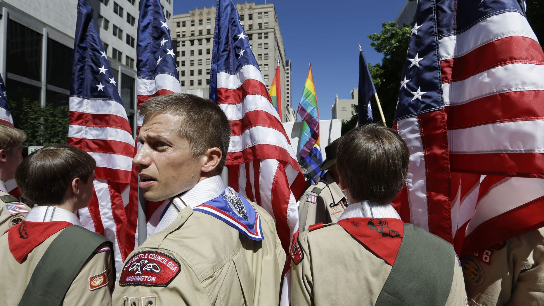 June 30, 2013: In this file photo, Boy Scouts from the Chief Seattle Council carry U.S. flags as they prepare to march in the Gay Pride Parade in downtown Seattle.