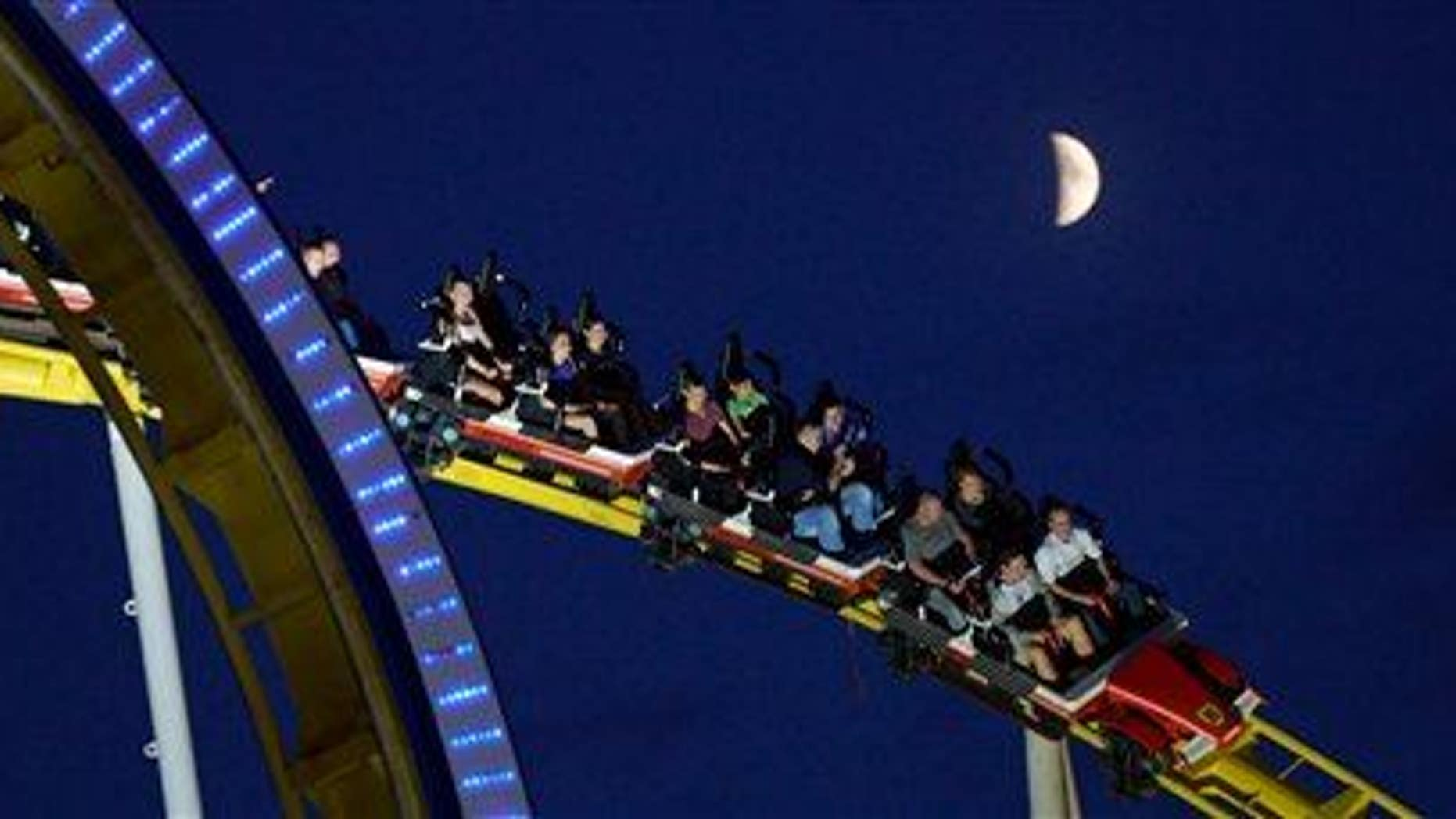 People enjoy a roller-coaster ride on July 4, 2014, in Hannover, Germany.