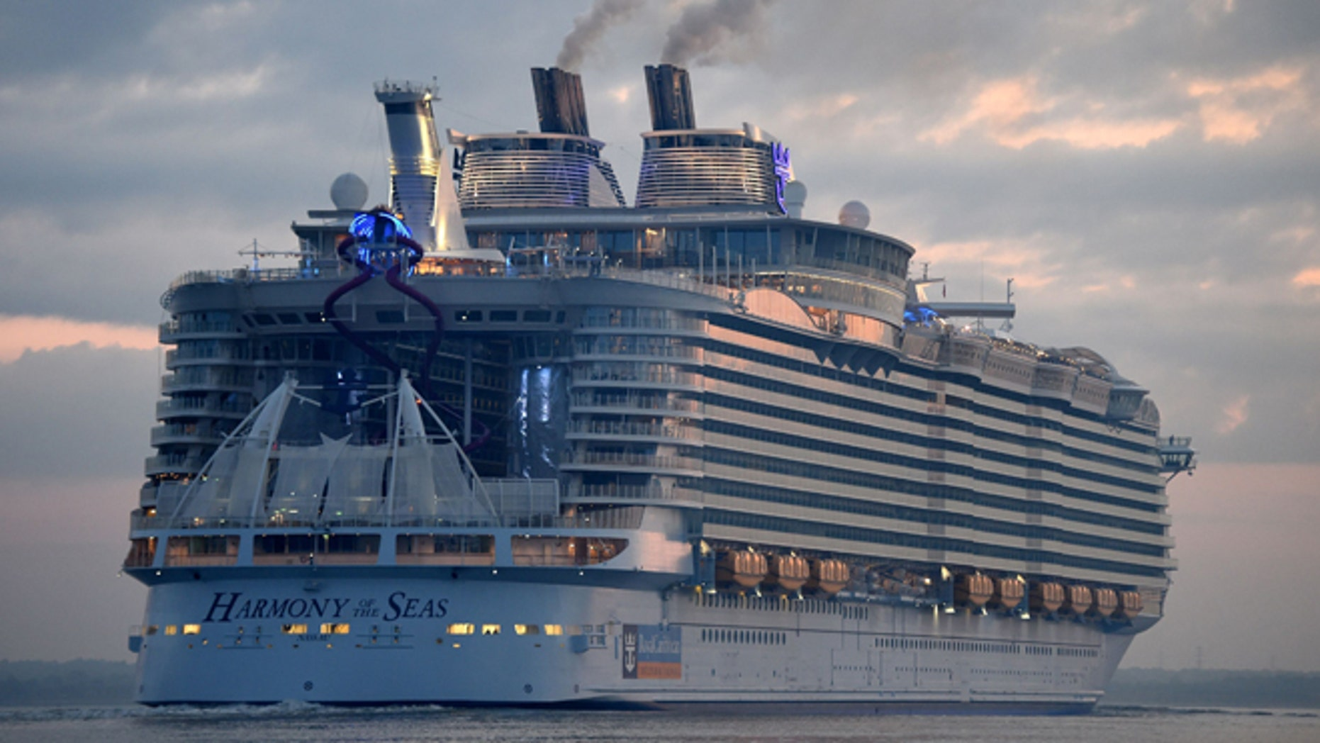 The world's largest passenger ship, Harmony of the Seas, owned by Royal Caribbean, docks on arrival in Southampton, England, Tuesday May 17, 2016, ahead of her maiden cruise. After 32-months being fitted out in a French shipyard the 16-deck Harmony of the Seas will set out on its inaugural voyage on May 22 bound for Barcelona, Spain.  (Andrew Matthews/PA via AP) UNITED KINGDOM OUT - NO SALES - NO ARCHIVES