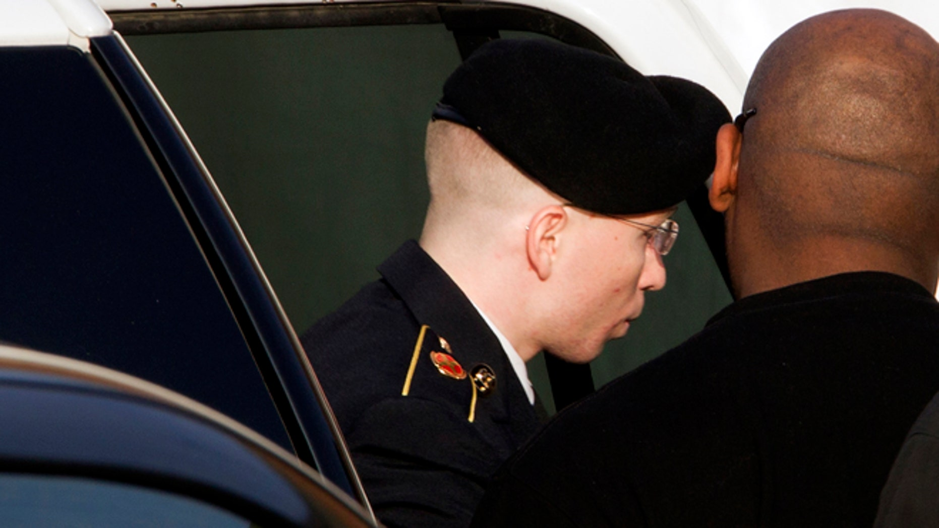 FILE Jan. 9, 2013: Army Pfc. Bradley Manning arrives to the courthouse for his motion hearing in Fort Meade in Maryland.