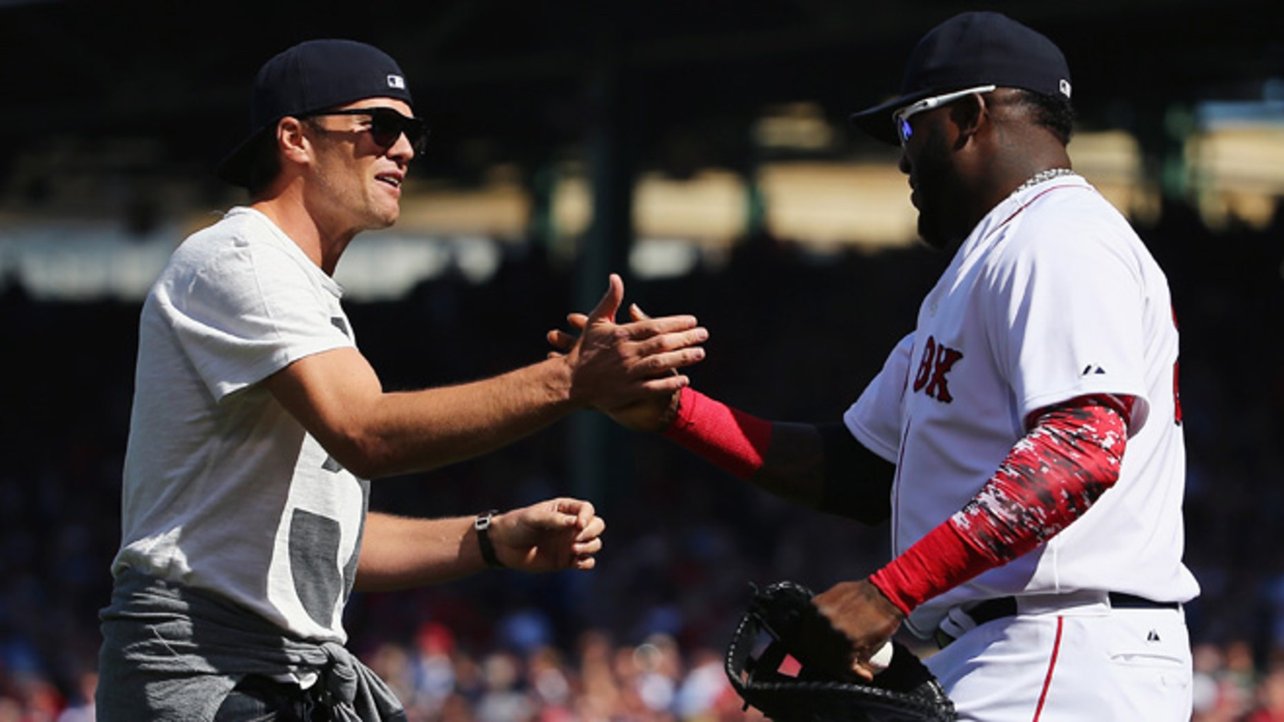 BOSTON, MA - APRIL 13:  New England Patriots quarterback Tom Brady talks with David Ortiz #34 of the Boston Red Sox after throwing out the first pitch before the game against the Washington Nationals at Fenway Park on April 13, 2015 in Boston, Massachusetts.  (Photo by Maddie Meyer/Getty Images)