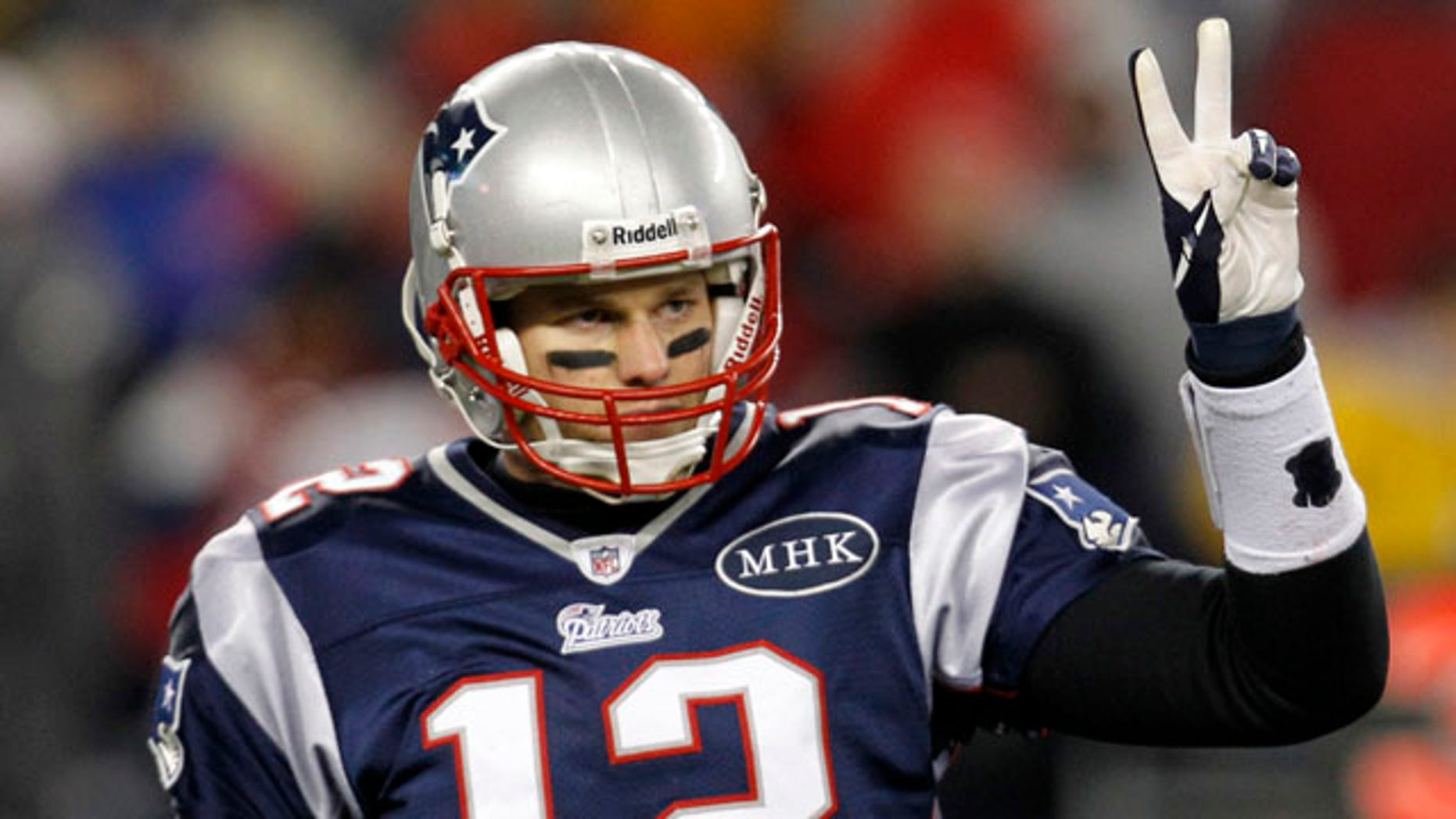 New England Patriots quarterback Tom Brady signals to his bench during the second half of an NFL divisional playoff football game against the Denver Broncos Saturday, Jan. 14, 2012, in Foxborough, Mass. (AP Photo/Elise Amendola)