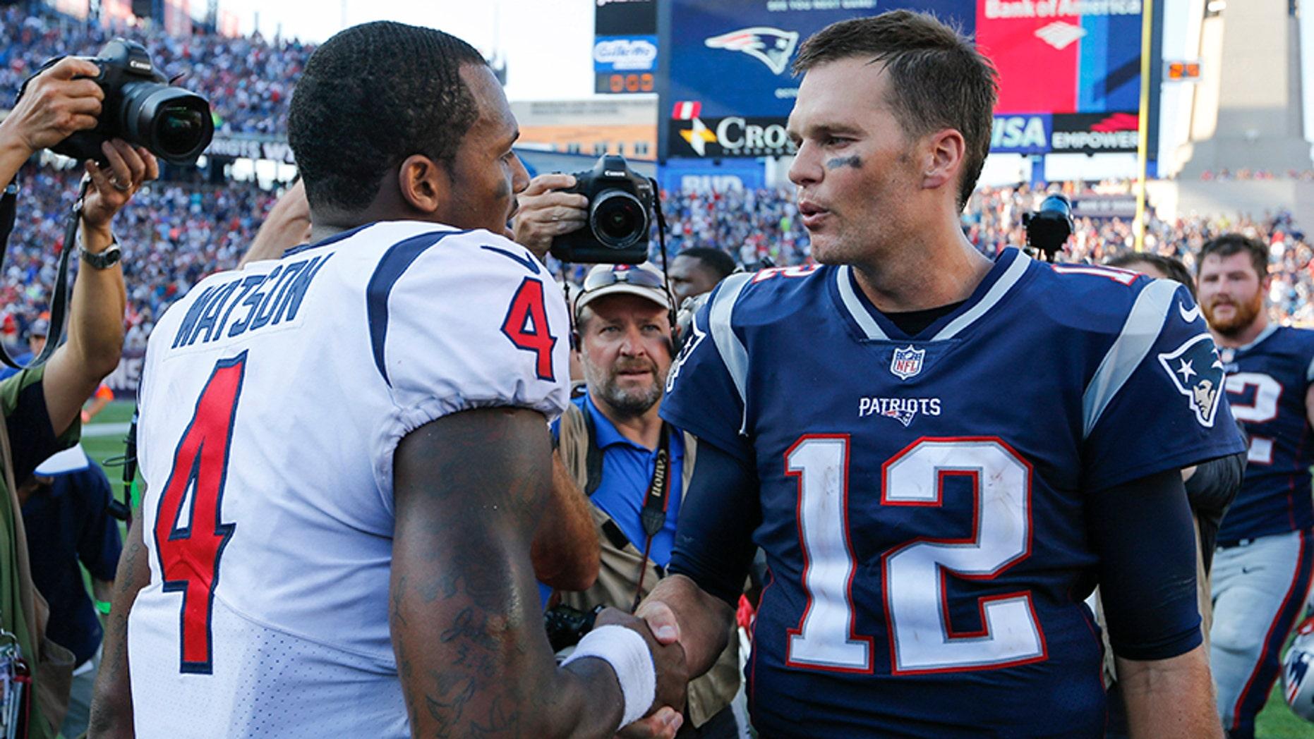 New England Patriots quarterback Tom Brady greets Houston Texans quarterback Deshaun Watson after their game in Foxborough, September 24, 2017.